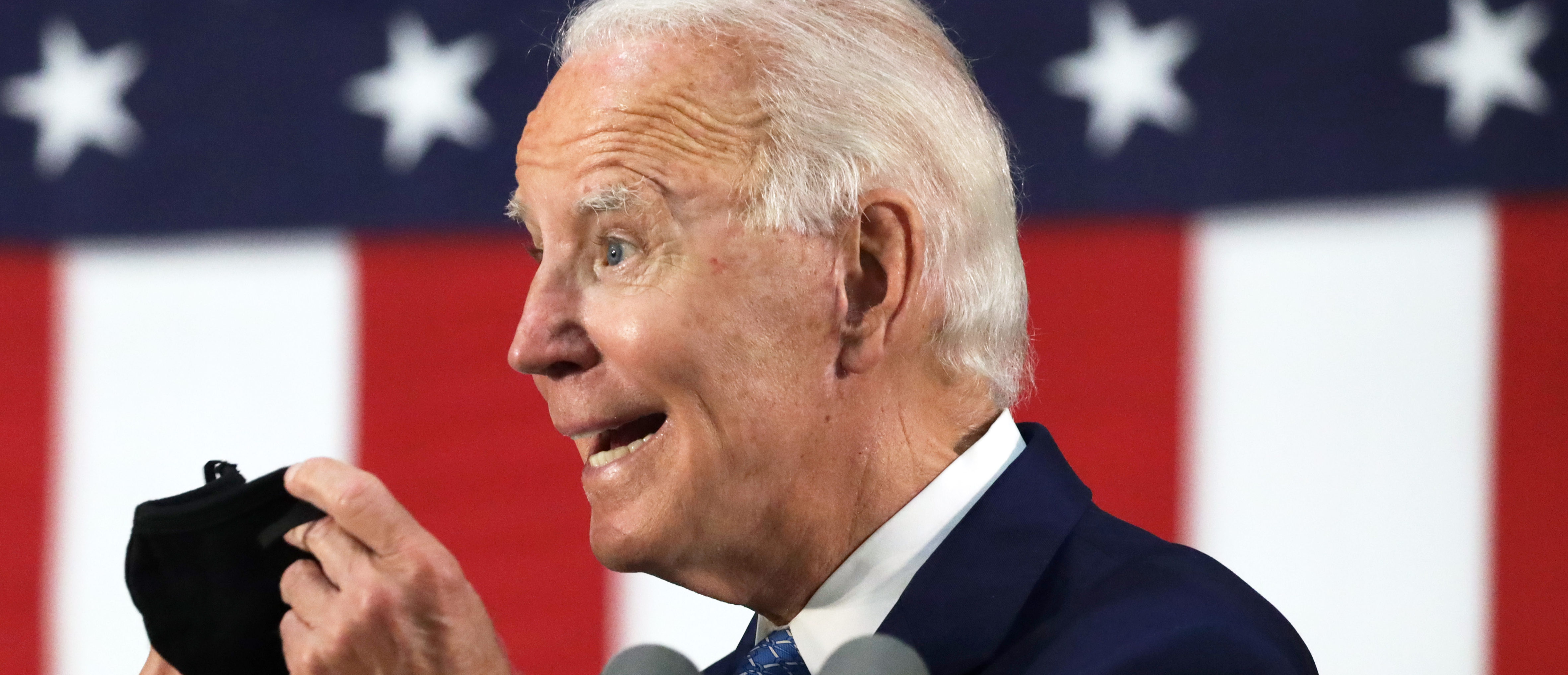 Democratic presidential candidate, former Vice President Joe Biden holds up a mask as he speaks during a campaign event June 30, 2020 at Alexis I. Dupont High School in Wilmington, Delaware. Biden discussed the Trump Administration's handling of the COVID-19 pandemic. Alex Wong/Getty Images