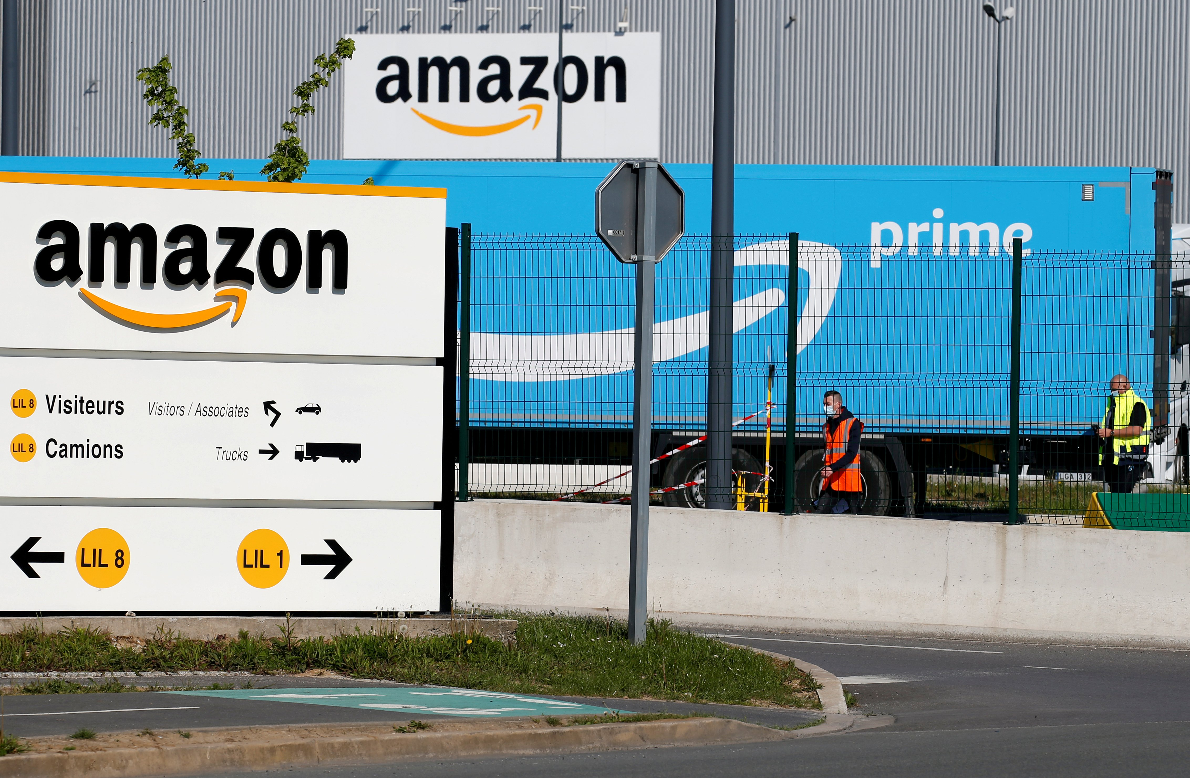 The logo of Amazon is seen at the company logistics center in Lauwin-Planque, northern France, April 22, 2020. REUTERS/Pascal Rossignol/File Photo
