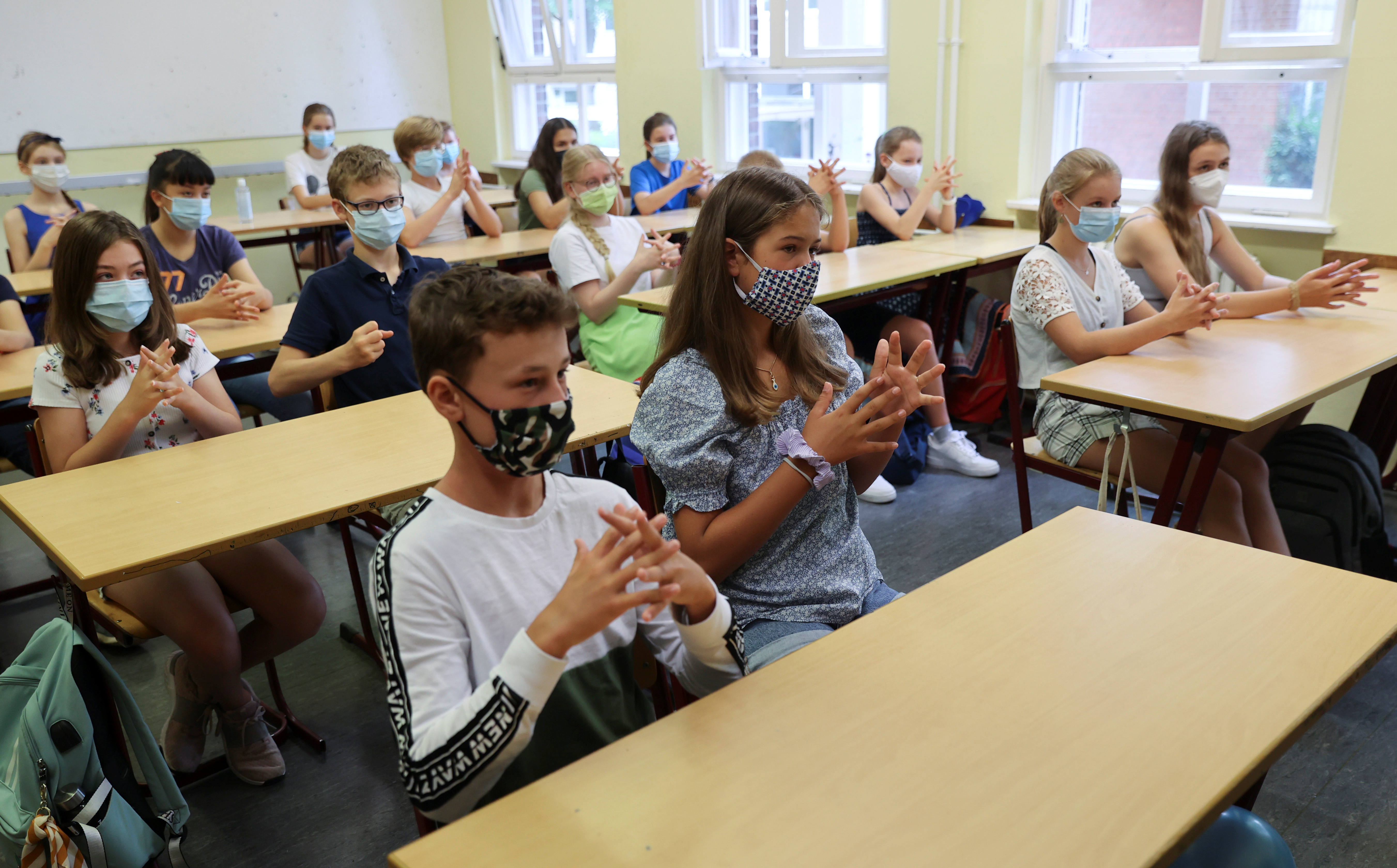 """Pupils of the protestant high school """"Zum Grauen Kloster"""" practice hand disinfection during their lesson on the first day after the summer holidays, amid the coronavirus disease (COVID-19) pandemic, in Berlin, Germany, August 10, 2020. REUTERS/Fabrizio Bensch"""