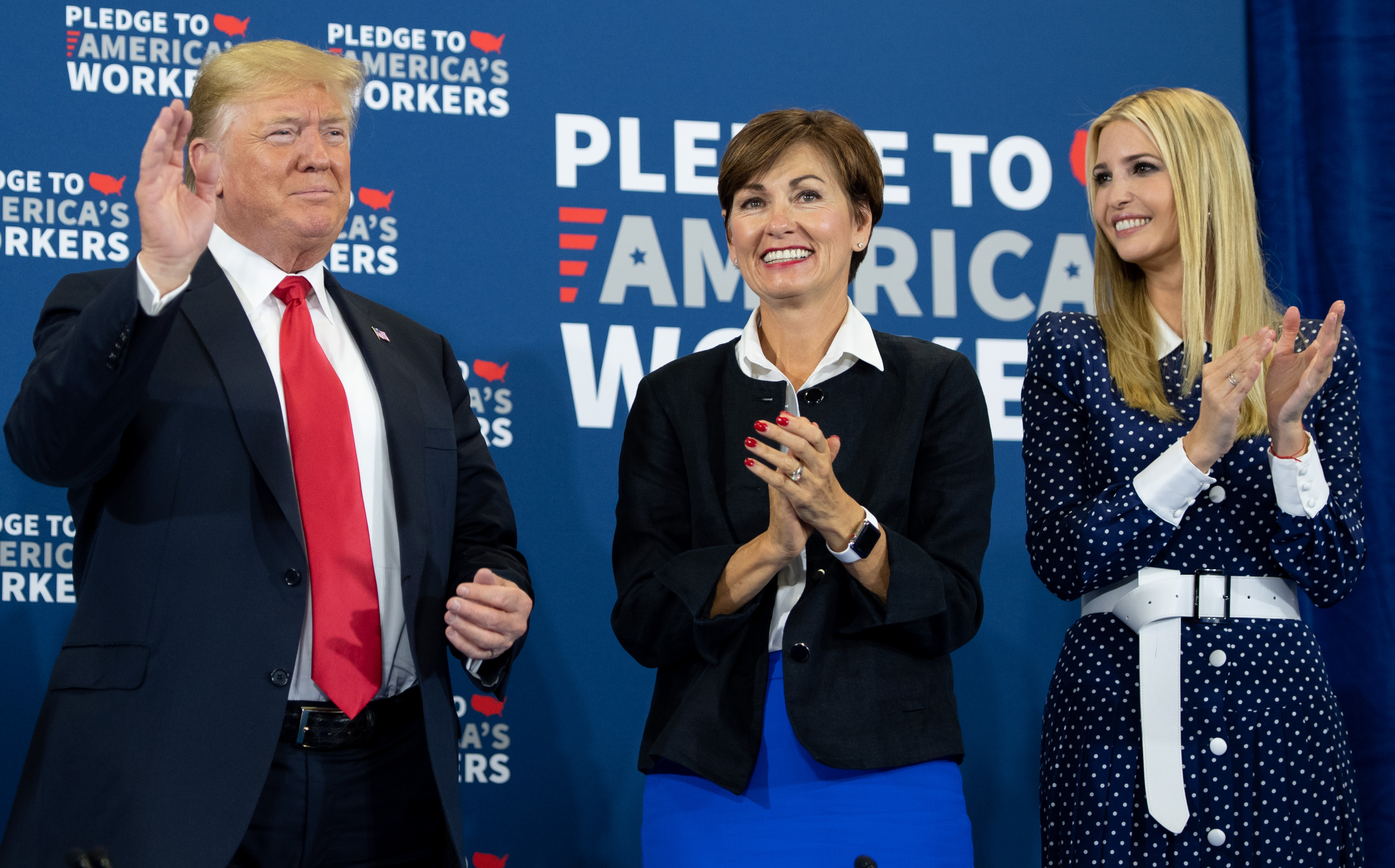 US President Donald Trump speaks, alongside Iowa Governor Kim Reynolds (C) and daughter Ivanka Trump (R), as he holds a roundtable discussion on workforce development at Northeast Iowa Community College in Peosta, Iowa, July 26, 2018. (SAUL LOEB/AFP via Getty Images)