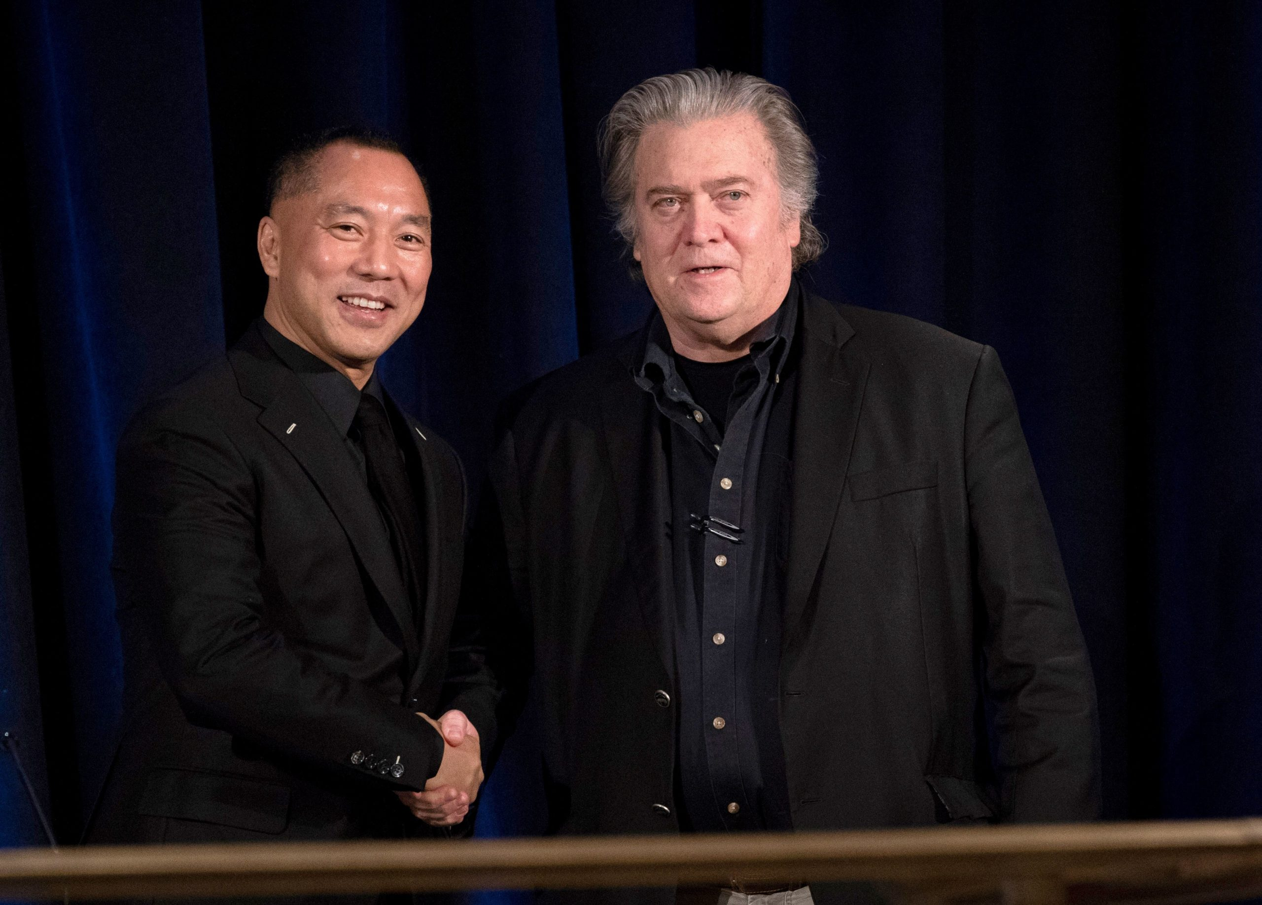 Former White House Chief Strategist Steve Bannon (R) greets fugitive Chinese billionaire Guo Wengui before introducing him at a news conference on November 20, 2018 in New York, on the death of of tycoon Wang Jian in France on July 3, 2018. (Photo by Don EMMERT / AFP) (Photo credit should read DON EMMERT/AFP via Getty Images)