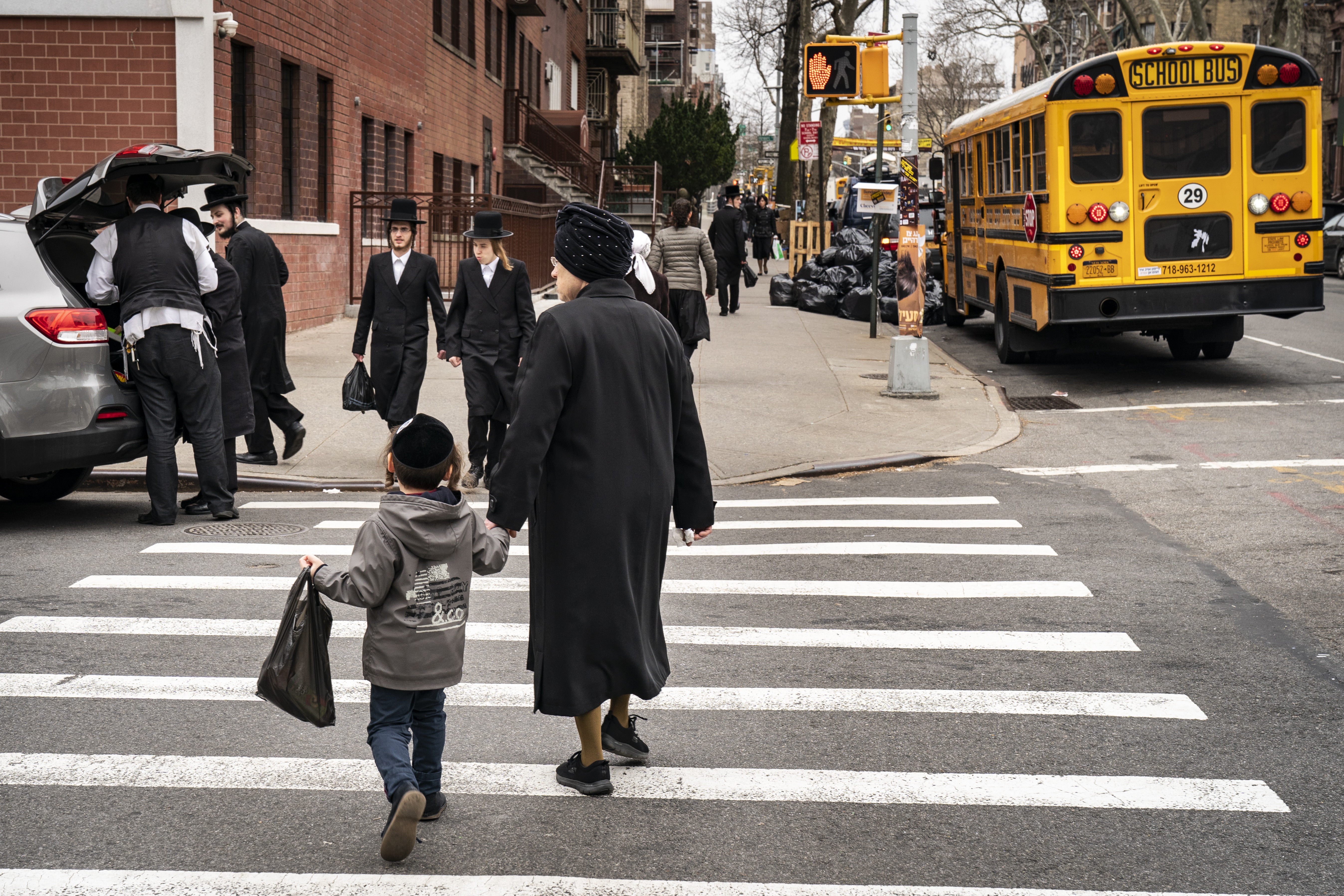 NEW YORK, NY - APRIL 9: Pedestrians walk near the Yeshiva Kehilath Yakov School in the South Williamsburg neighborhood, April 9, 2019 in the Brooklyn borough of New York City. (Photo by Drew Angerer/Getty Images)
