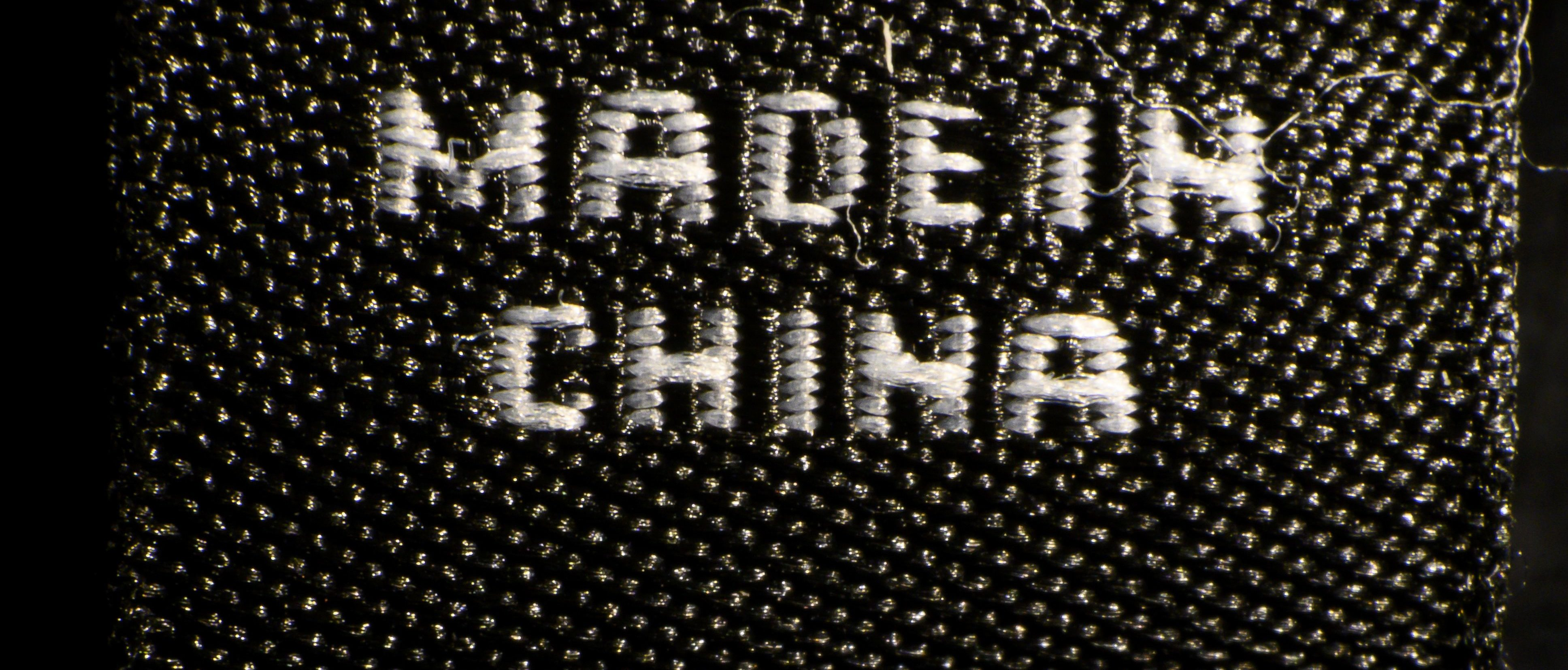 A photo illustration shows a label inside an item of clothing reading