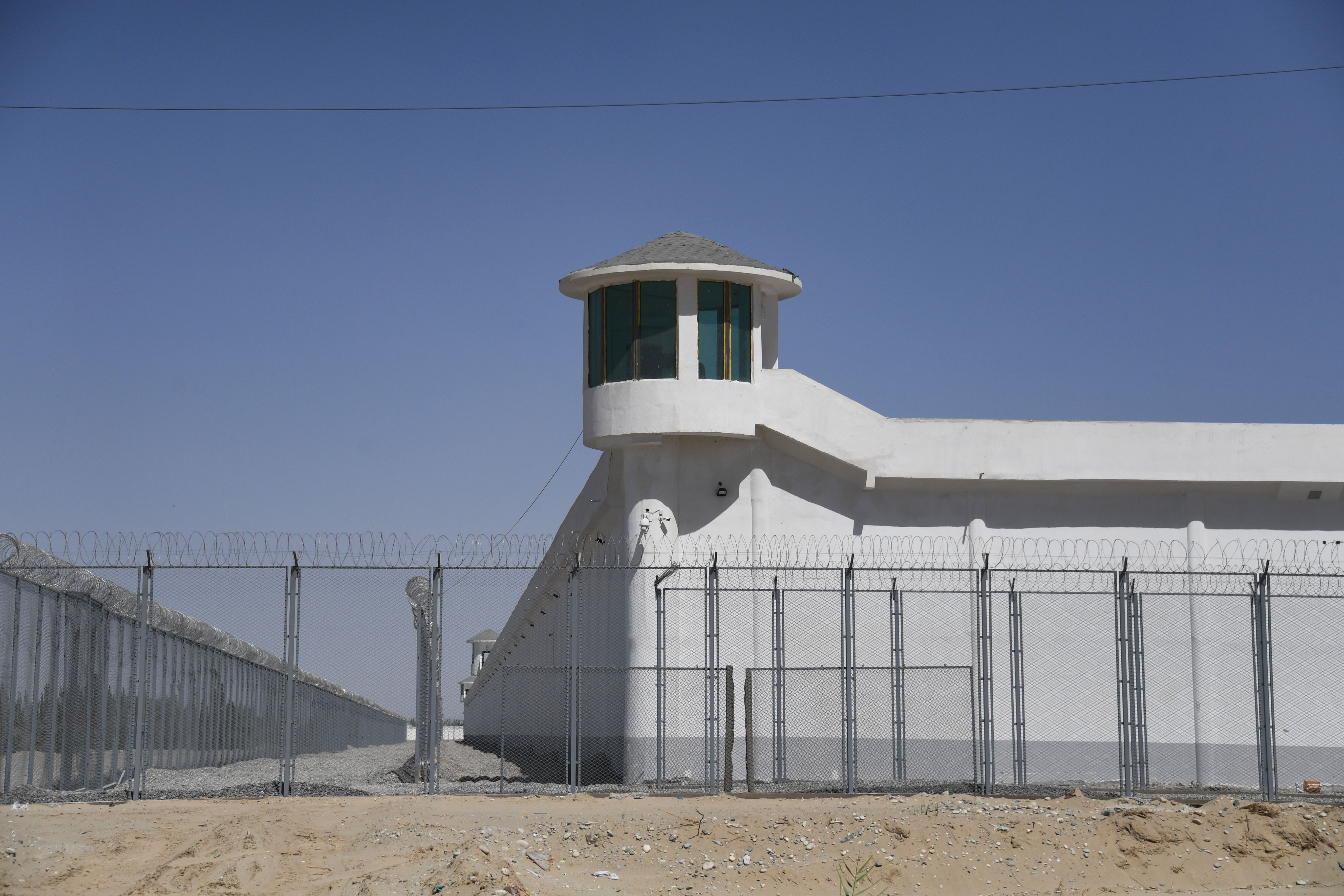 This photo taken on May 31, 2019 shows a watchtower on a high-security facility near what is believed to be a re-education camp where mostly Muslim ethnic minorities are detained, on the outskirts of Hotan, in China's northwestern Xinjiang region. (GREG BAKER/AFP via Getty Images)
