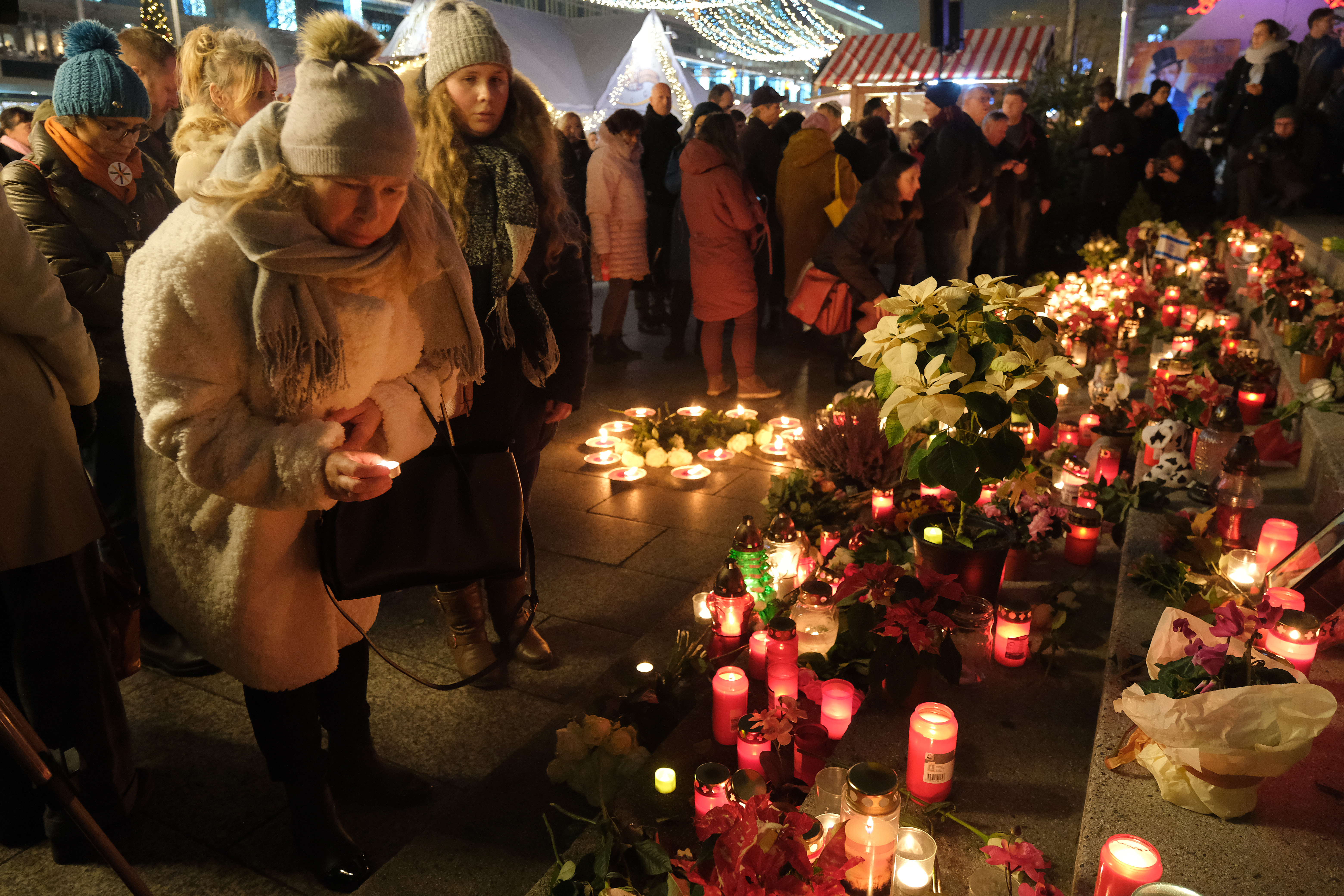 BERLIN, GERMANY - DECEMBER 19: Members of the public stand at the memorial to commemorate the 2016 Christmas market terror attack at Breitscheidplatz shortly after an official ceremony on the third anniversary of the attack on December 19, 2019 in Berlin, Germany. (Photo by Sean Gallup/Getty Images)