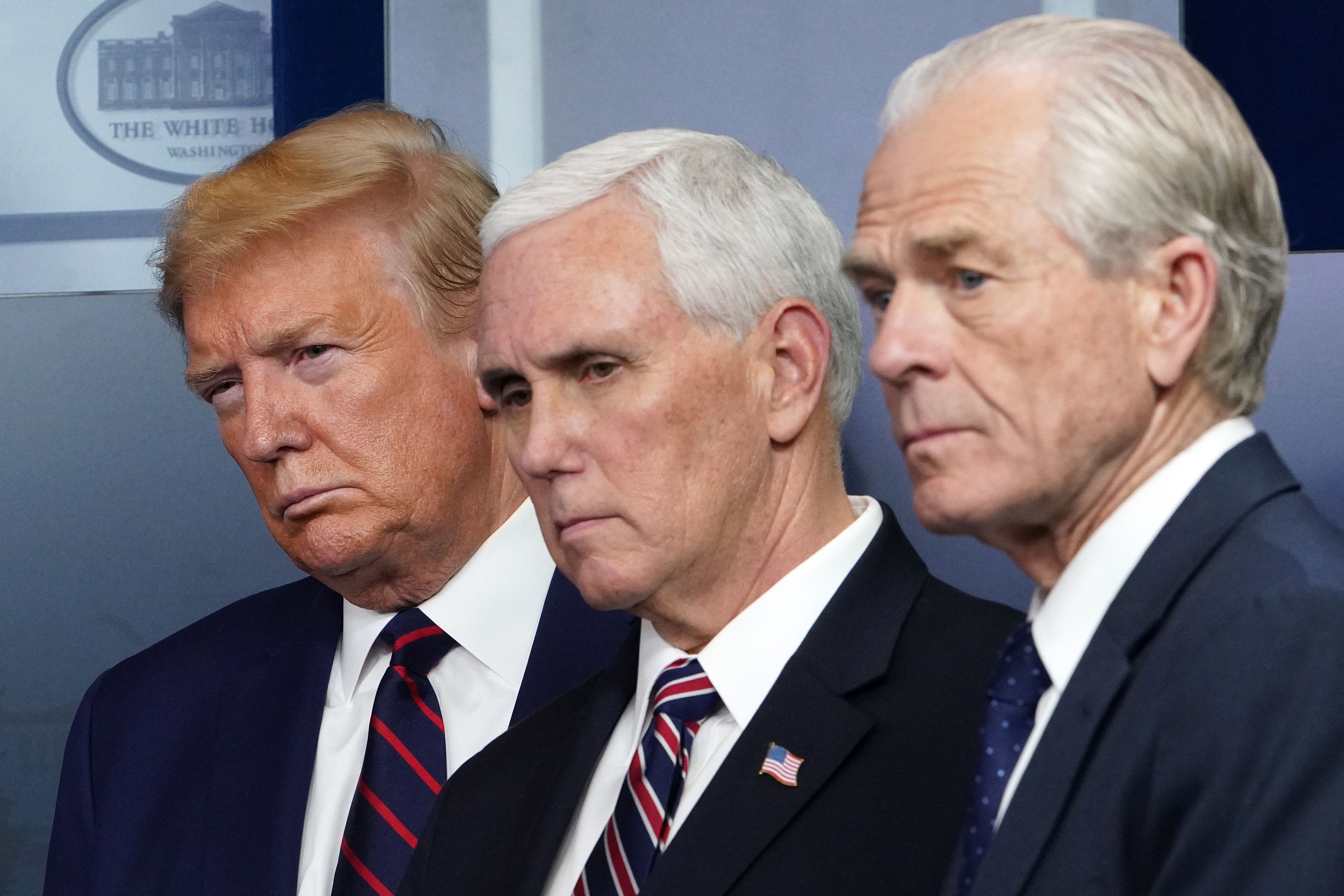 (From L) US President Donald Trump, US Vice President Mike Pence and Director of Trade and Manufacturing Policy Peter Navarro look on during the daily briefing on the novel coronavirus, COVID-19, in the Brady Briefing Room at the White House on April 2, 2020, in Washington, DC. (Photo by MANDEL NGAN/AFP via Getty Images)