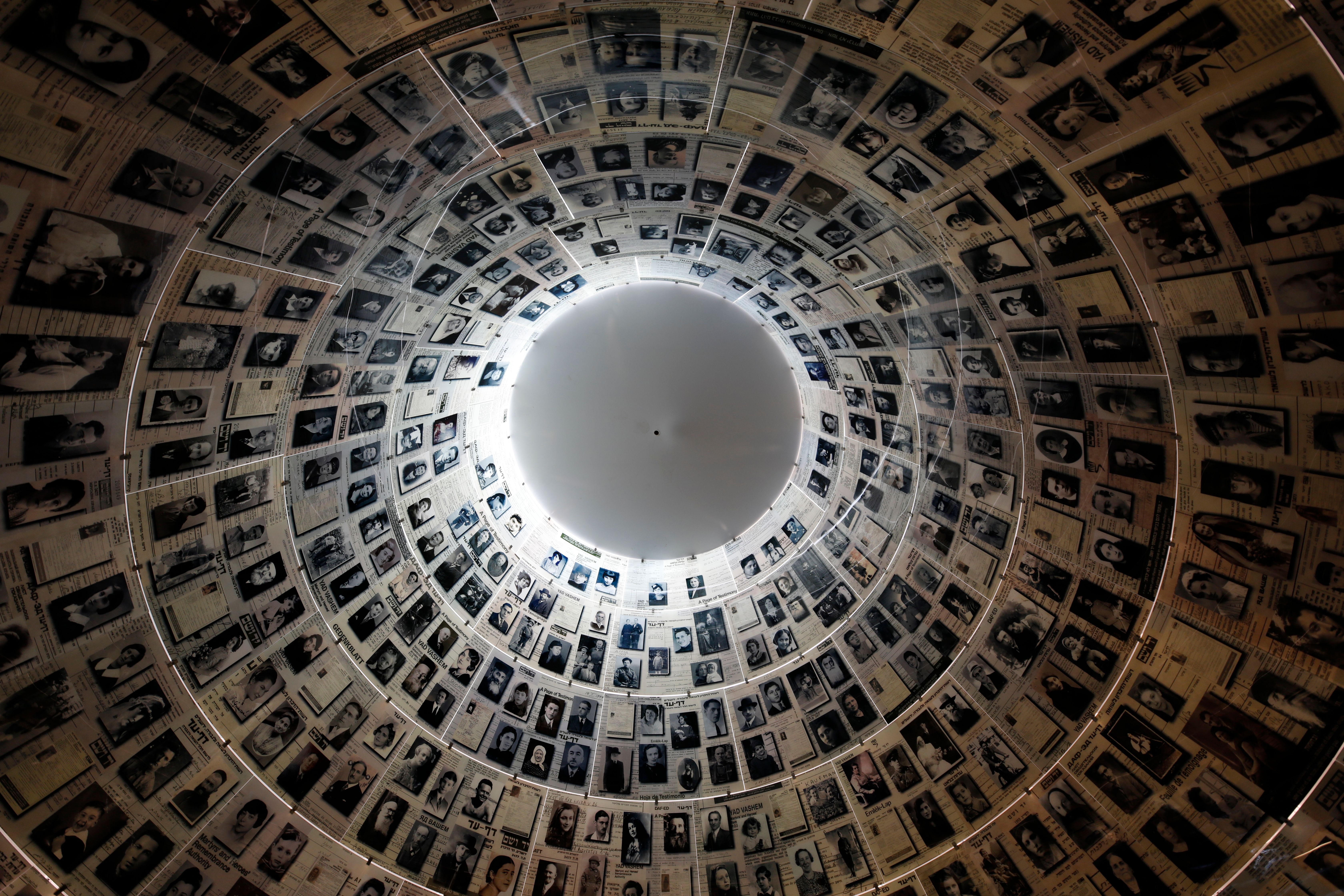 A picture taken on April 20, 2020, shows a view of the cieling in the Hall of Names, bearing names and pictures of Jewish Holocaust victims, at the Yad Vashem Holocaust memorial museum in Jerusalem. - Movement and travel restrictions in place to contain the pandemic have forced this week's Holocaust Remembrance Day -- Yom HaShoah in Hebrew -- to be exclusively digital for the first time. In a normal year, symbolic events are organised at various locations, notably with survivors at the sites in Europe where the Nazis built concentration and extermination camps. This year, testimonials from survivors will be streamed online and featured in a pre-recorded ceremony to be broadcast in Israel by Jerusalem's Yad Vashem Holocaust memorial centre, when Yom HaShoah begins on this evening. (Photo by MENAHEM KAHANA / AFP) (Photo by MENAHEM KAHANA/AFP via Getty Images)