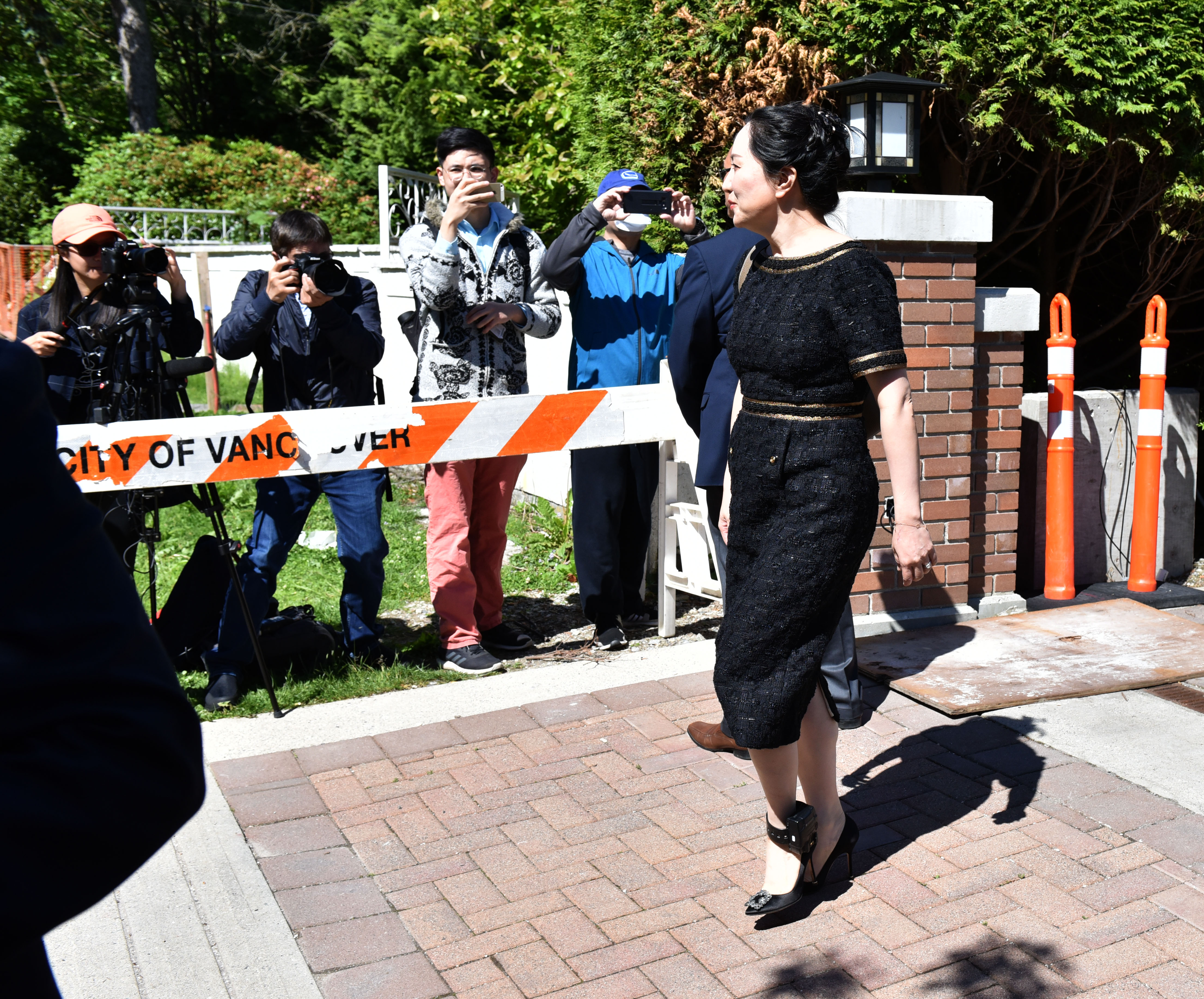 Chinese Huawei tech executive Meng Wanzhou leaves her Vancouver home on May 27 ,2020, to appear in British Columbia Supreme Court. - Meng Wanzhou was dealt a legal setback Wednesday when a Canadian judge ruled that proceedings to extradite her to the US will go ahead. The decision on so-called double criminality, a key test for extradition, found that bank fraud accusations against Meng would stand up in Canada. The interim ruling denying Meng's attempt to gain her freedom means she will continue to live in Vancouver under strict bail conditions while her case plays out. (Photo by Don MacKinnon/AFP via Getty Images)