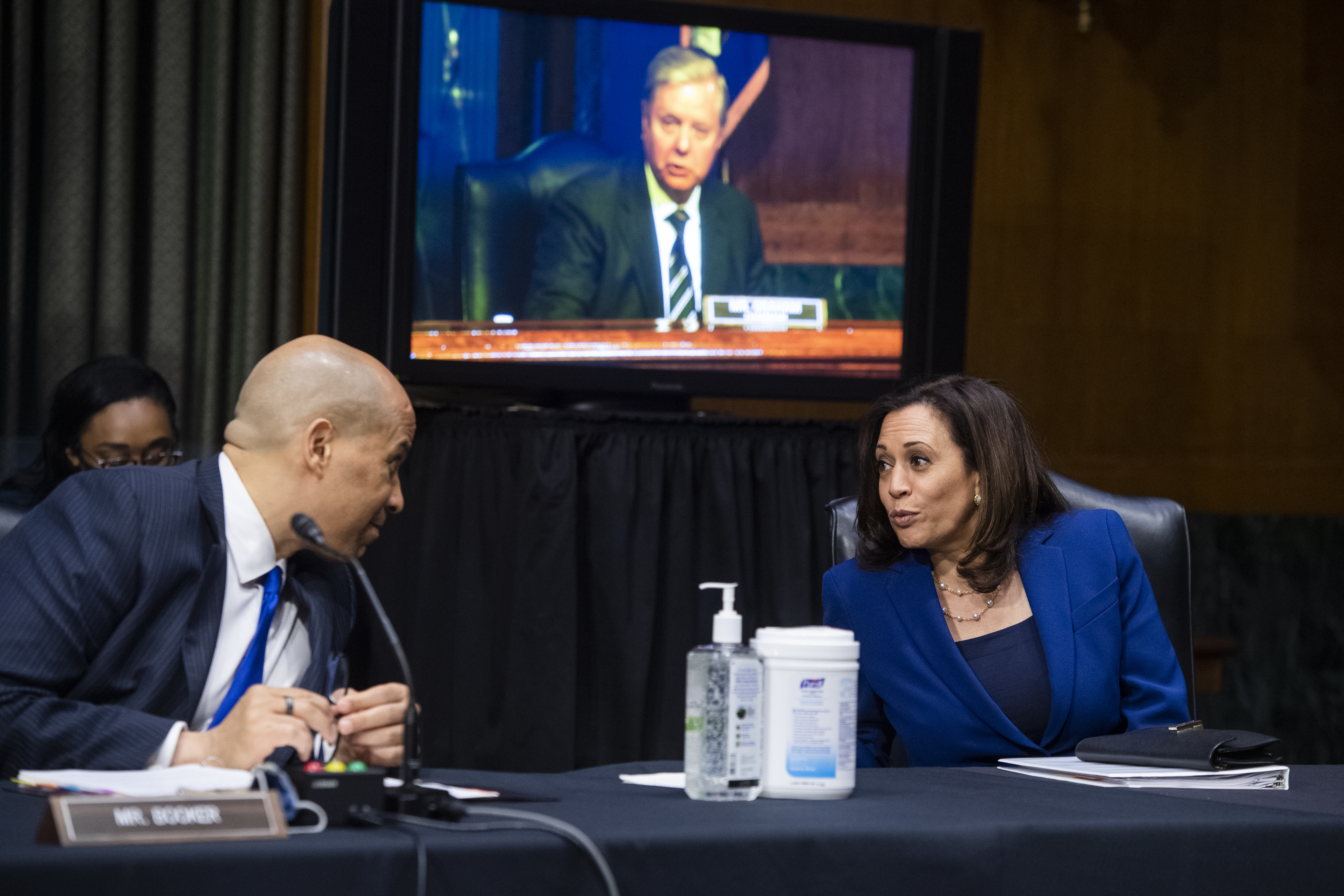WASHINGTON, DC - JUNE 16: Sen. Cory Booker (D-NJ) talks to Sen. Kamala Harris (D-CA) during a Judiciary Committee hearing in the Dirksen Senate Office Building on June 16, 2020 in Washington, D.C. The Republican-led committee was holding its first hearing on policing since the death of George Floyd while in Minneapolis police custody on May 25. (Tom Williams-Pool/Getty Images)