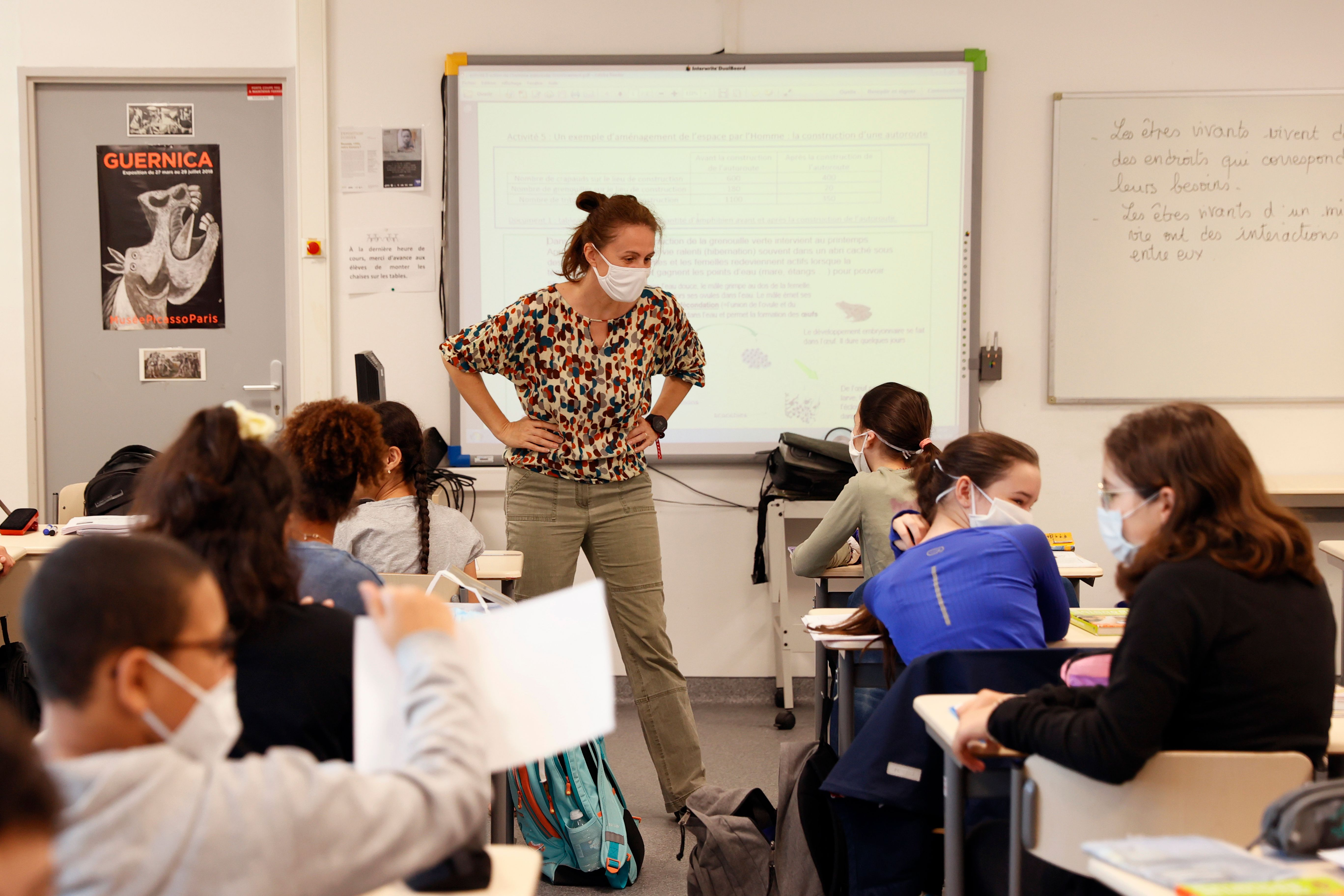 Middle school pupils attend a lesson in their classroom, on June 22, 2020 in Boulogne-Billancourt, outside Paris, as primary and middle schools reopen in France. (Thomas Samson/AFP via Getty Images)