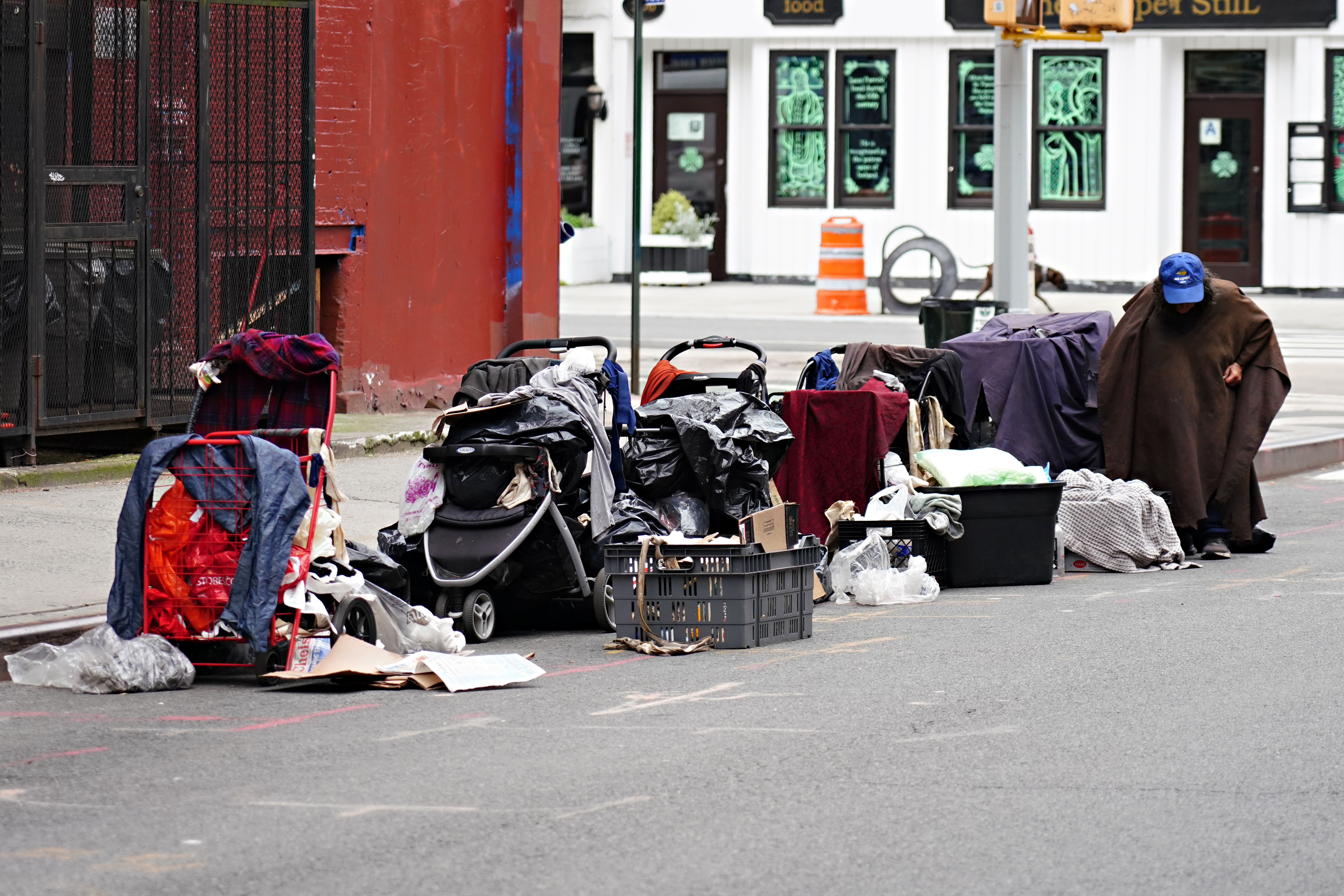 NEW YORK, NEW YORK - MAY 24: A homeless person sits with their belongings on the street during the coronavirus pandemic on May 24, 2020 in New York City. COVID-19 has spread to most countries around the world, claiming over 343,000 lives with over 5.3 million infections reported. (Photo by Cindy Ord/Getty Images)