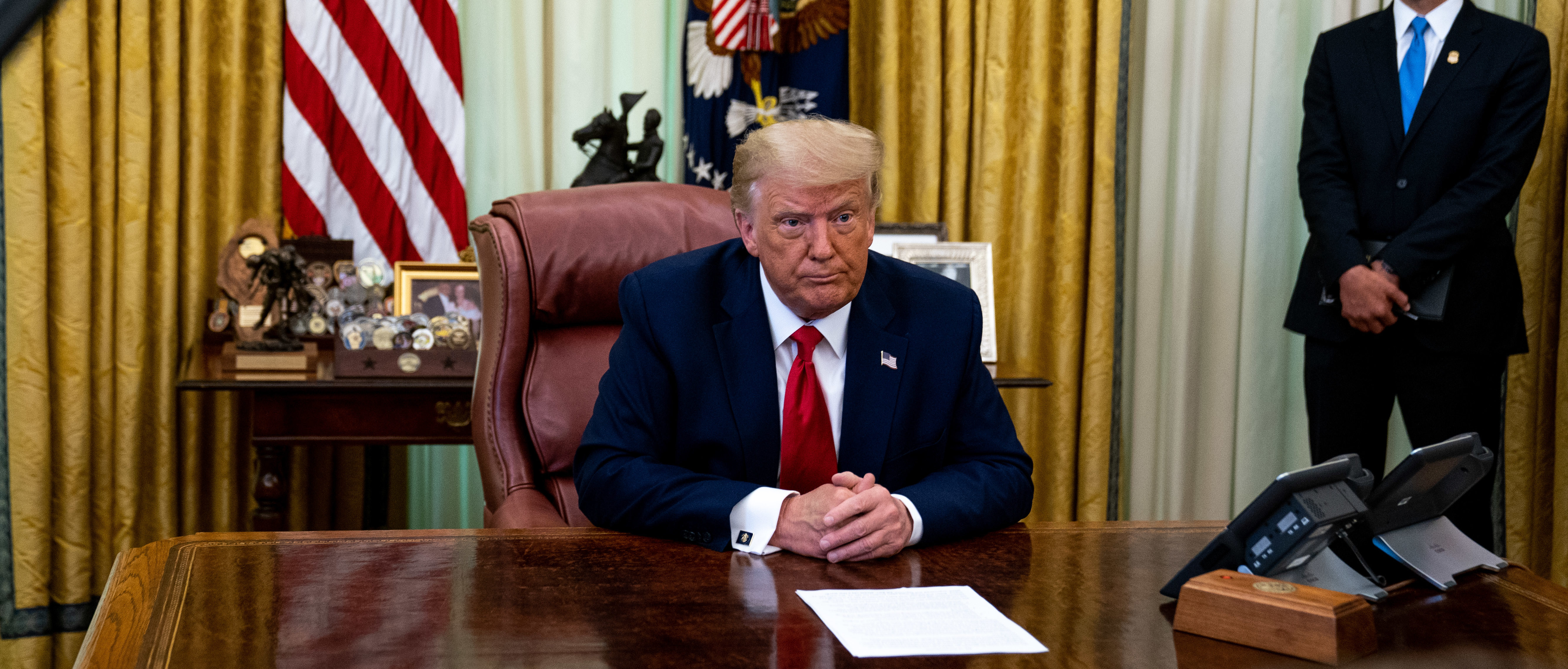 """WASHINGTON, DC - JULY 15: President Donald Trump speaks in the Oval Office of the White House after receiving a briefing from law enforcement on """"Keeping American Communities Safe: The Takedown of Key MS-13 Criminal Leaders"""" on July 15th 2020 in Washington DC. (Photo by Anna Moneymaker-Pool/Getty Images)"""