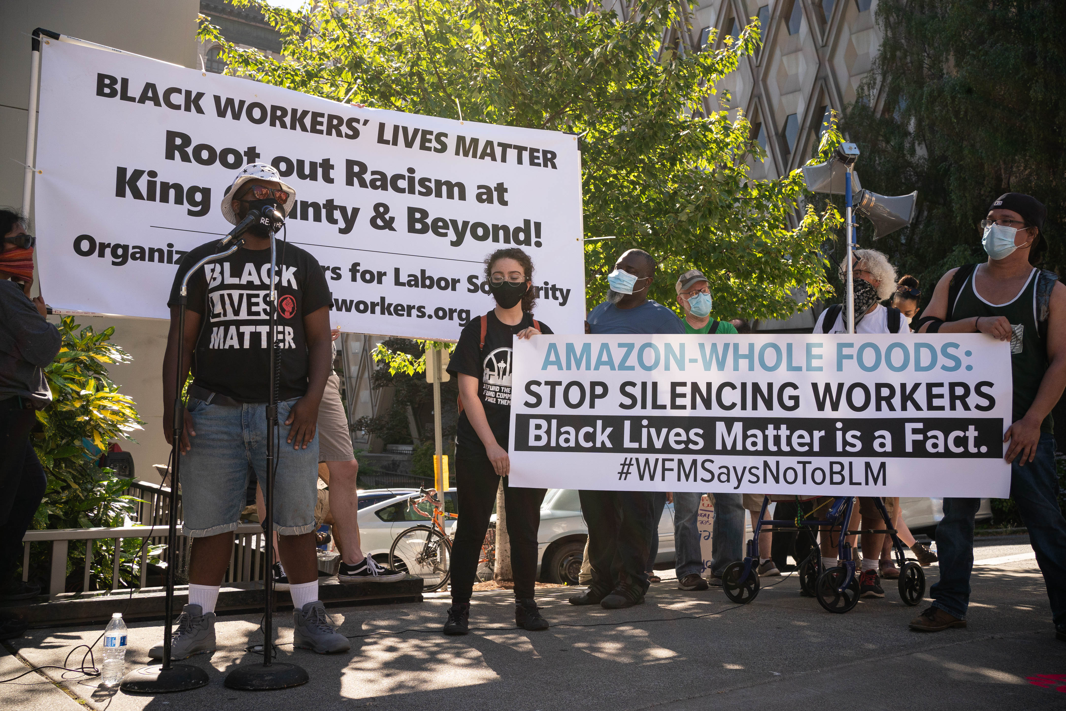 Workers from a Seattle Whole Foods speak as part of the nationwide Strike For Black Lives on July 20. (David Ryder/Getty Images)