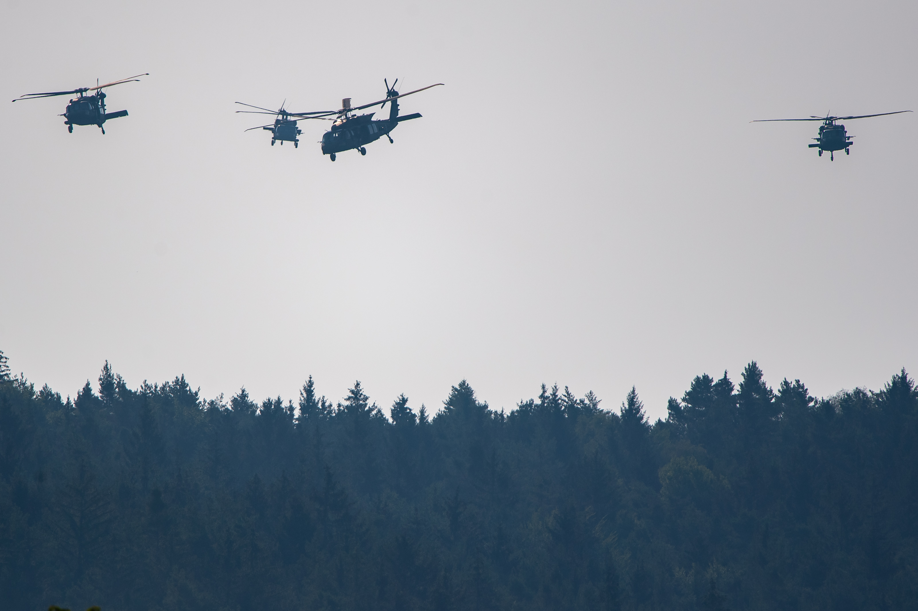 Black Hawk UH-60 helicopters fly by while participating in the Saber Junction 20 military exercises at the Hohenfels training grounds on August 10, 2020 near Hohenfels, Germany. (Photo by Lennart Preiss/Getty Images)