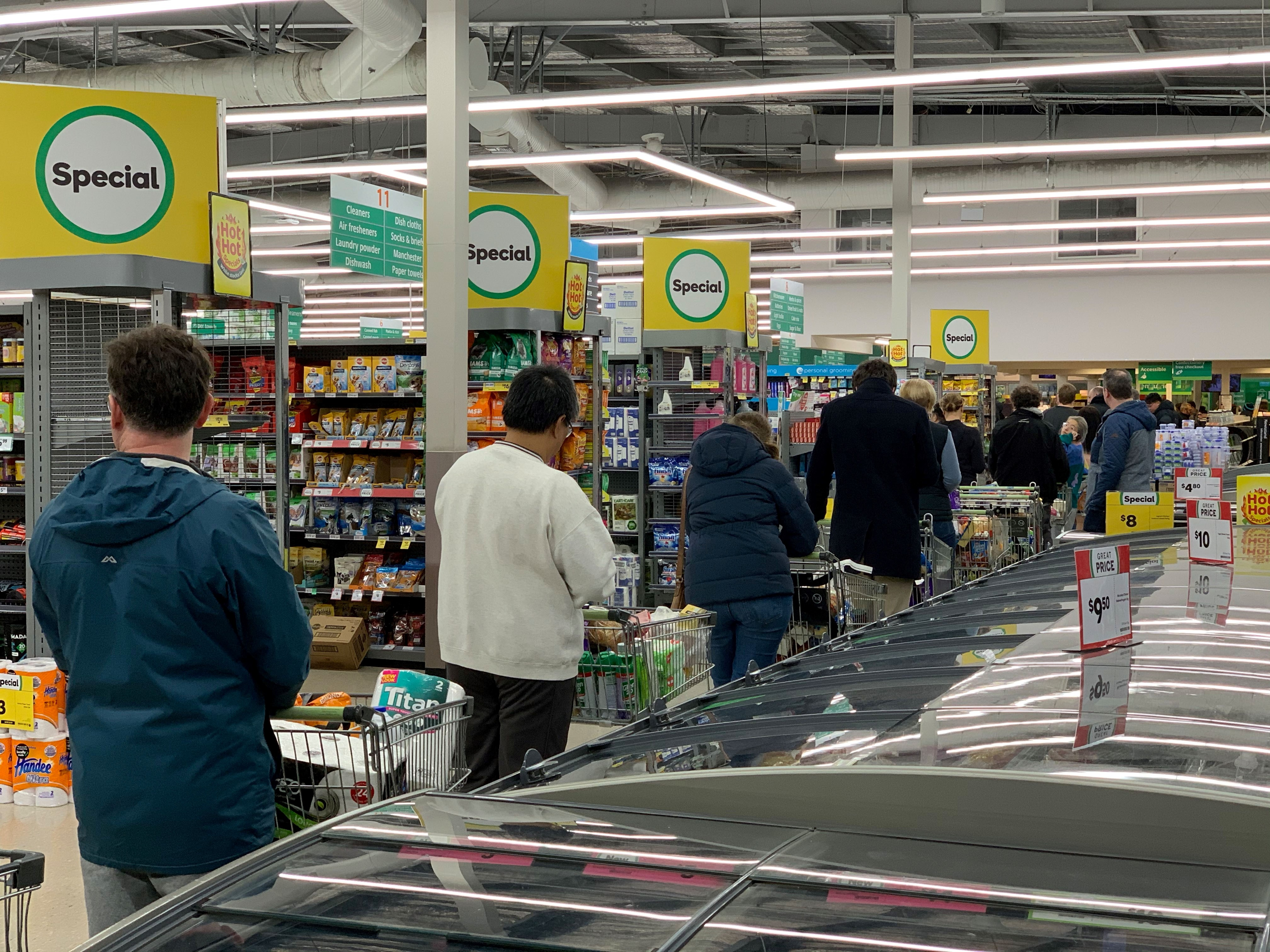 Shoppers shop at a supermarket in the suburb of Johnsonville in Wellington on August 11, 2020. - Auckland has been place at level 3 lockdown and the rest of the country has moved to level 2 after a family in South Auckland tested positive for covid. (Photo by MARTY MELVILLE/AFP via Getty Images)