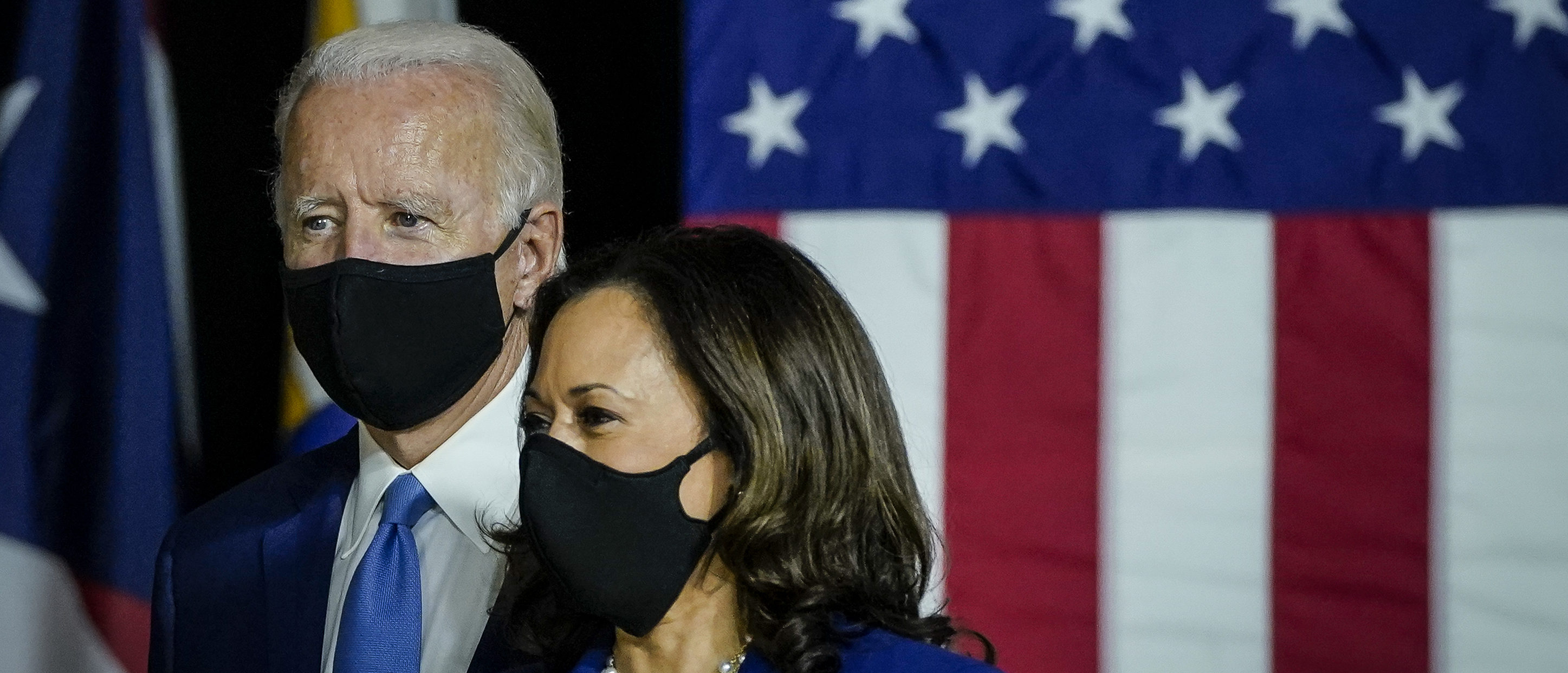 Democratic presidential candidate former Vice President Joe Biden and his running mate Sen. Kamala Harris (D-CA) arrive to deliver remarks at the Alexis Dupont High School on August 12, 2020 in Wilmington, Delaware. (Drew Angerer/Getty Images)
