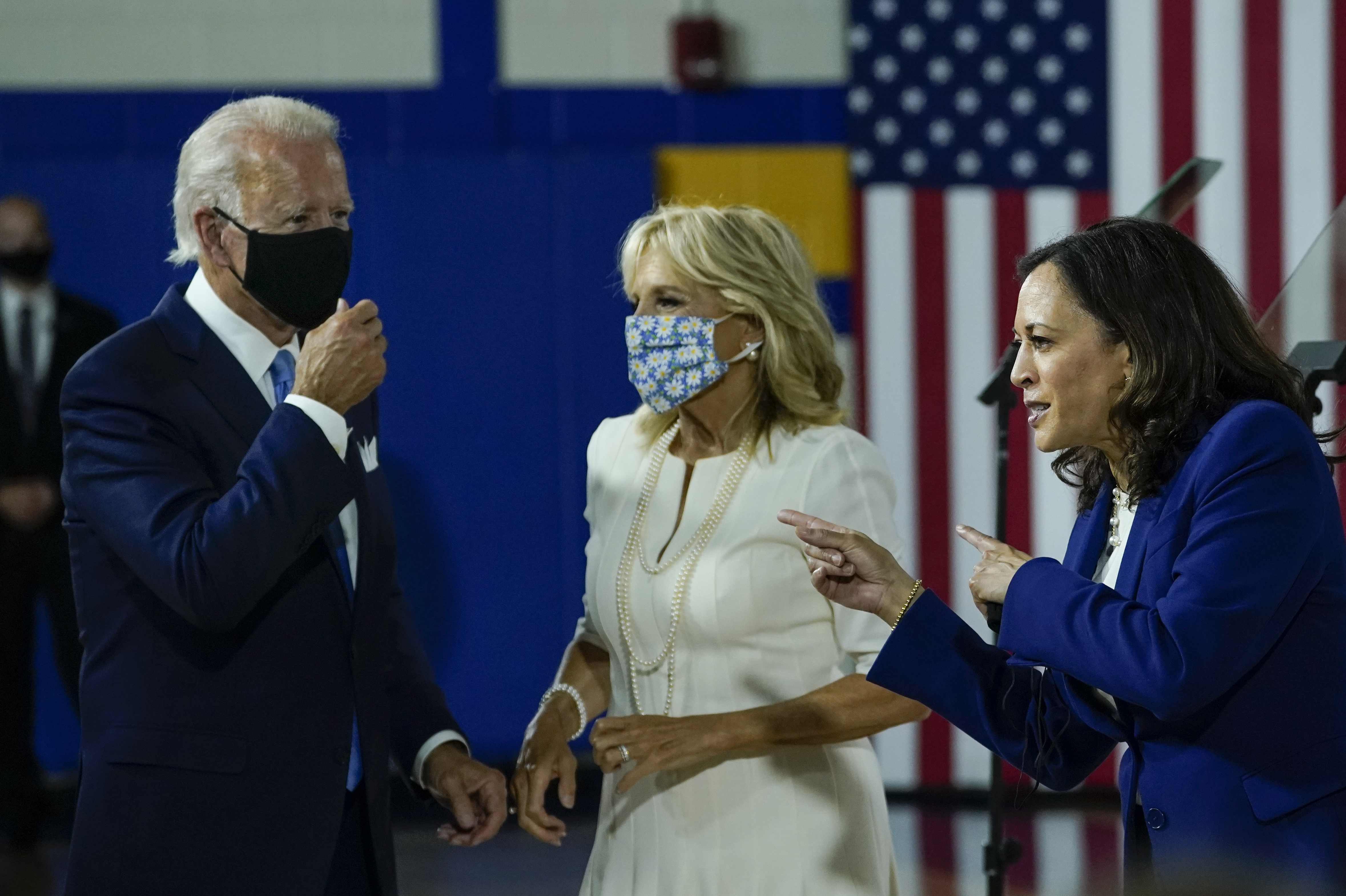 Democratic presidential candidate former Vice President Joe Biden, his wife Dr. Jill Biden; and Sen. Kamala Harris (D-CA), who was introduced as Joe Biden's running mate in the upcoming general election, mingle following the event at the Alexis Dupont High School on August 12, 2020 in Wilmington, Delaware. (Drew Angerer/Getty Images)