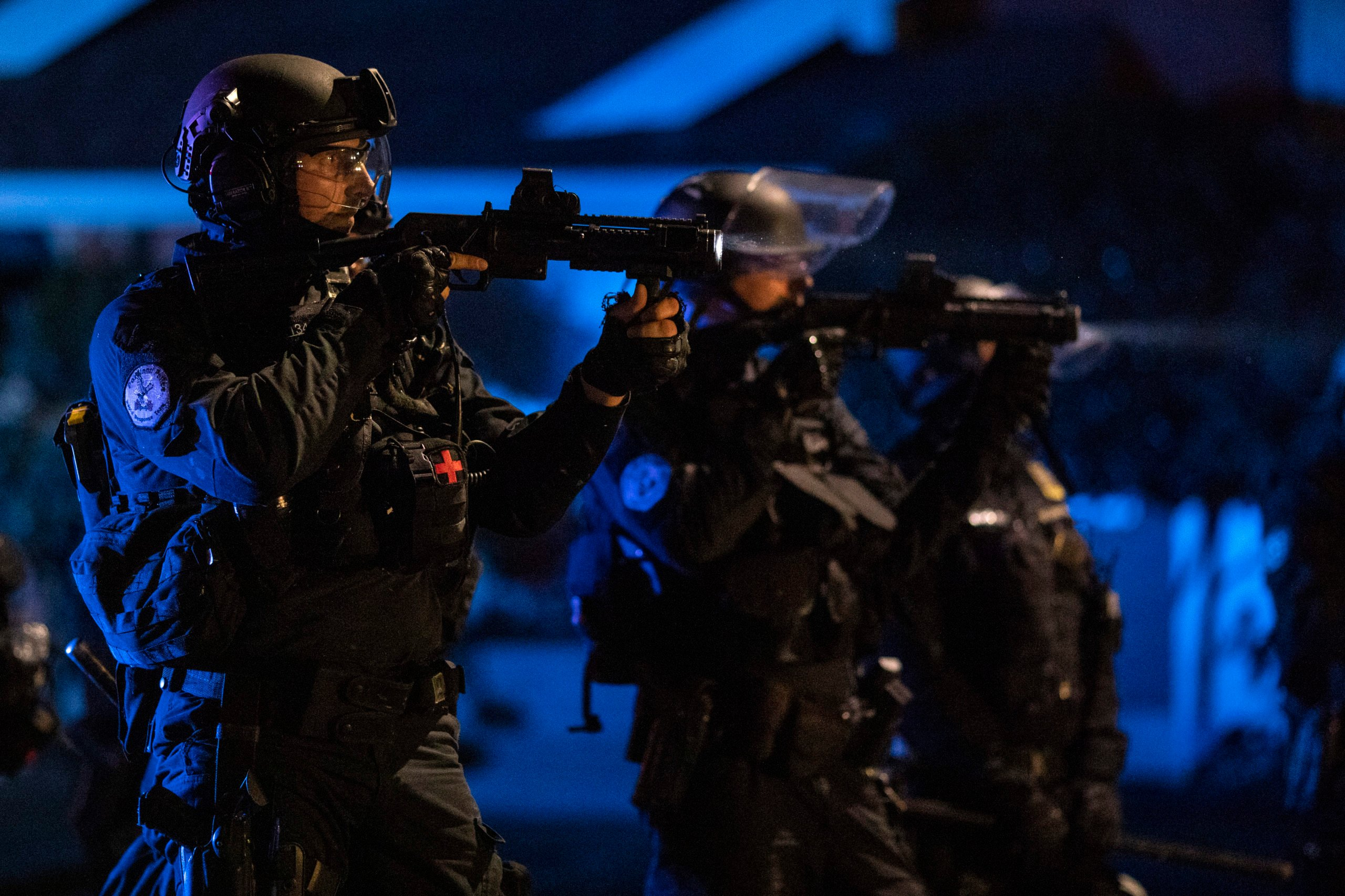 PORTLAND, OR - AUGUST 16 : Portland police are seen in riot gear during a standoff with protesters in Portland, Oregon on August 16, 2020. Protests have continued for the 80th consecutive night in Portland since the killing of George Floyd. (Photo by Paula Bronstein/Getty Images )