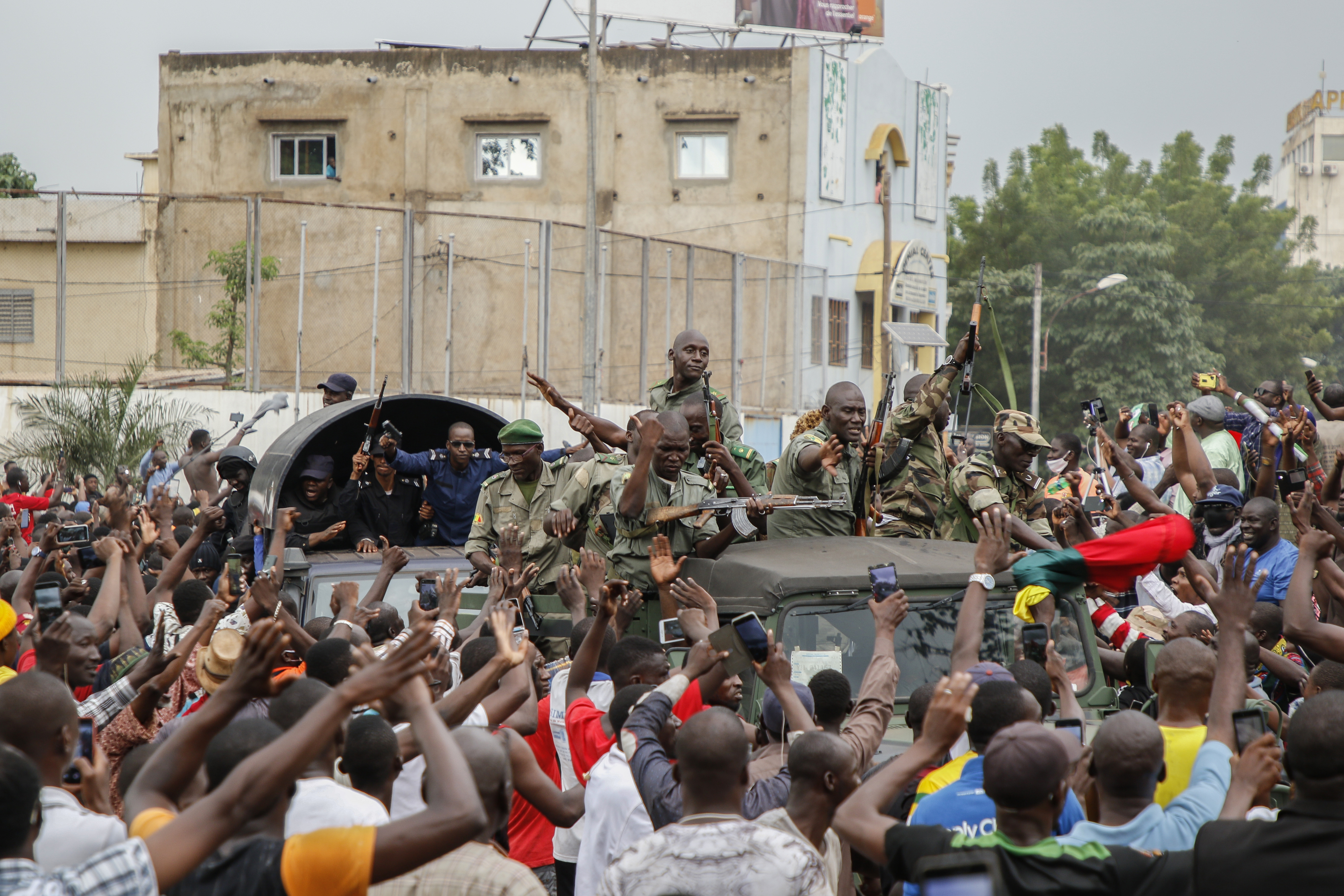 BAMAKO, MALI - AUGUST 18: Crowds cheer as soldiers parade in vehicles along the Boulevard de l'Independance on August 18, 2020 in Bamako, Mali. President Ibrahim Boubacar Keita and Prime Minister Boubou Cisse have been taken captive by mutinying soldiers, according to multiple news reports. Their arrest was preceded by a takeover the Kati military camp, about 15km from Bamako.(Photo by John Kalapo/Getty Images)