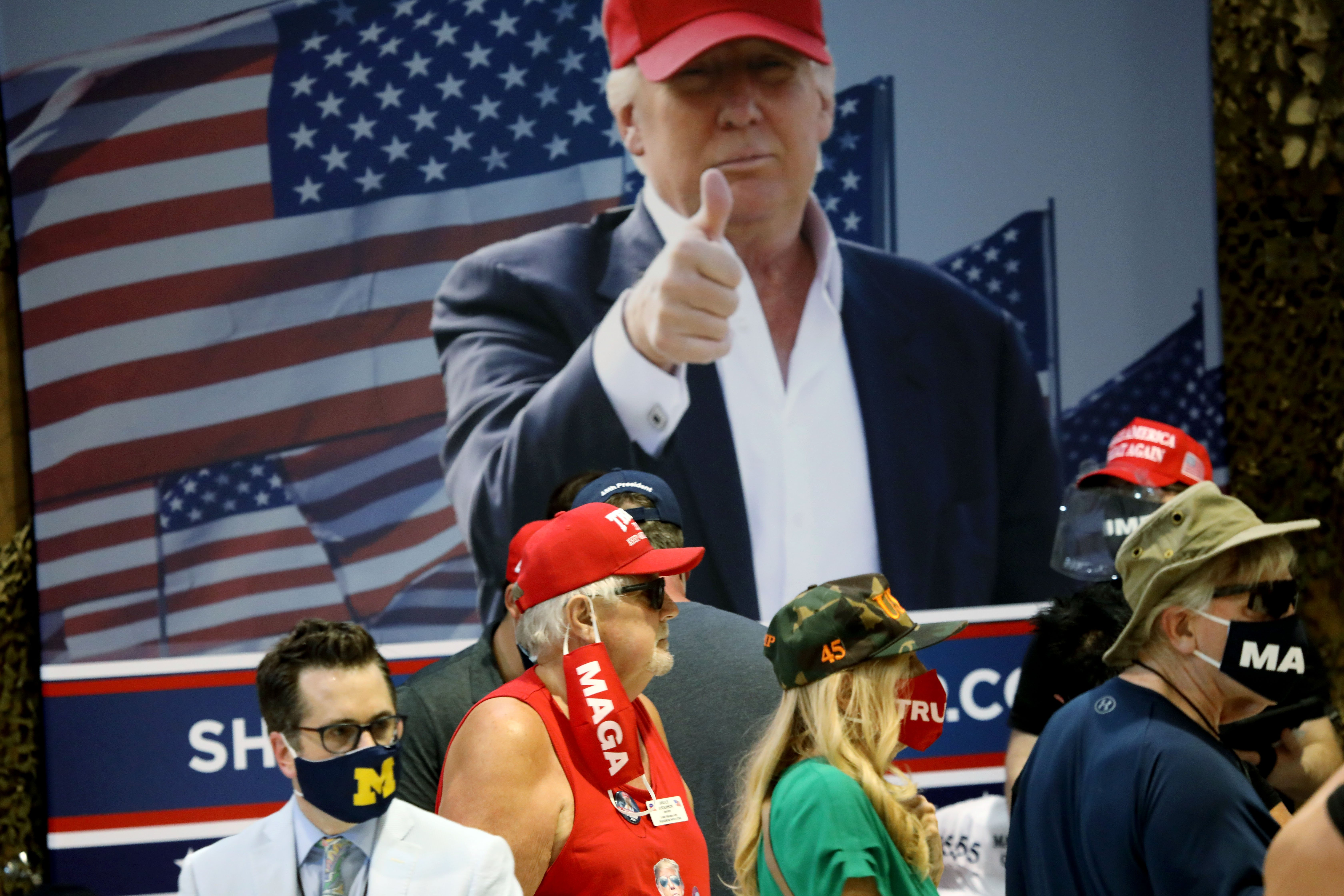 YUMA, AZ - AUGUST 18: Supporters of U.S. President Donald Trump attend a campaign rally at The Defense Contractor Complex on August 18, 2020 in Yuma, Arizona. Trump excoriated presumptive Democratic nominee former Vice President Joe Biden as being soft on illegal immigration as Democrats hold their convention this week remotely from Milwaukee. Hundreds waited in line in 104-degree heat to see the president, many without masks or maintaining distance from others, according to published reports. The crowd size inside the hangar was limited in a nod to the ongoing pandemic that has hit Yuma County particularly hard. (Photo by Sandy Huffaker/Getty Images)