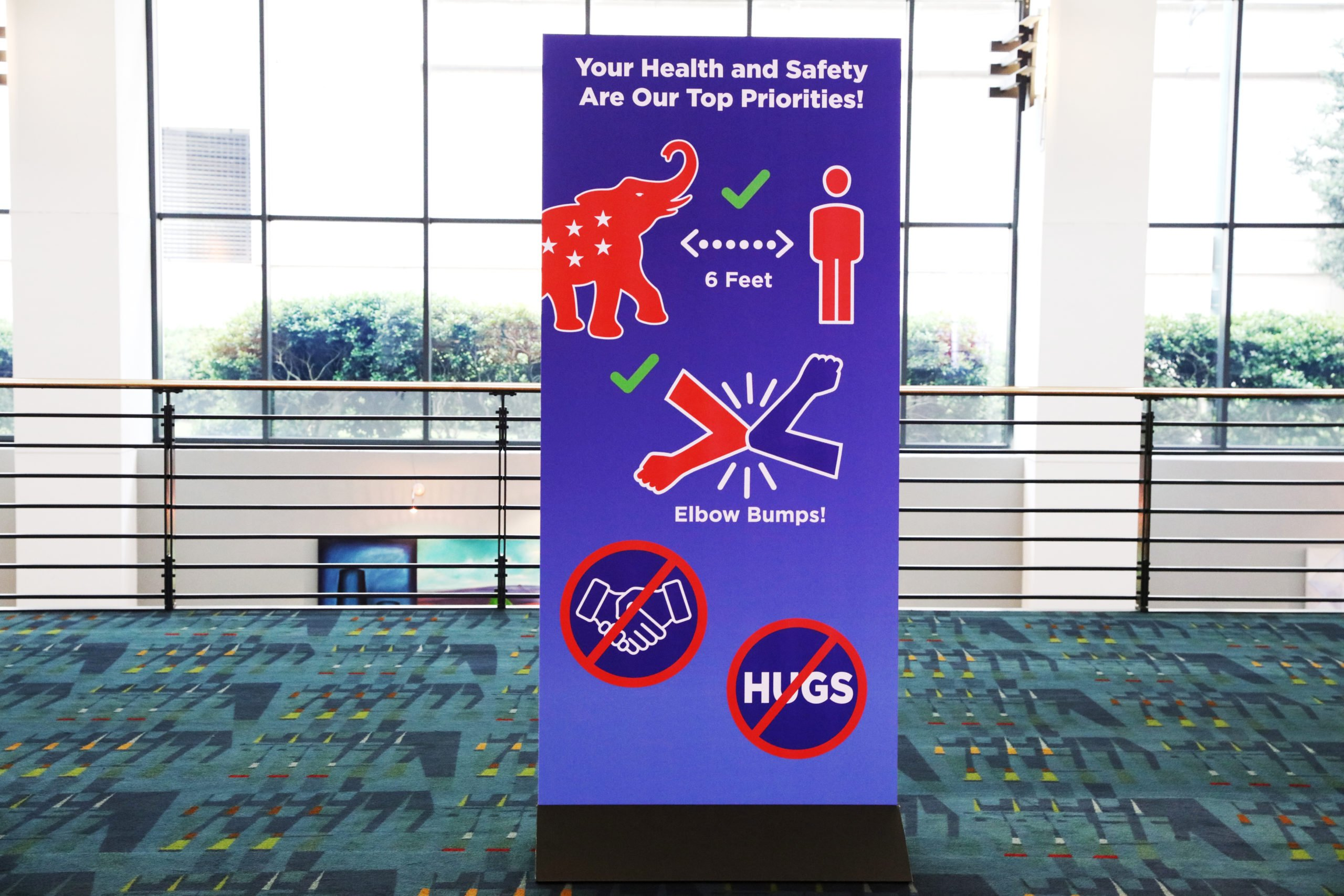 CHARLOTTE, NORTH CAROLINA - AUGUST 24: Social distancing signs are displayed outside the Charlotte Convention Center's Richardson Ballroom for the Republican National Convention at the Charlotte Convention Center on August 24, 2020 in Charlotte, North Carolina. (Photo by Travis Dove - Pool/Getty Images)