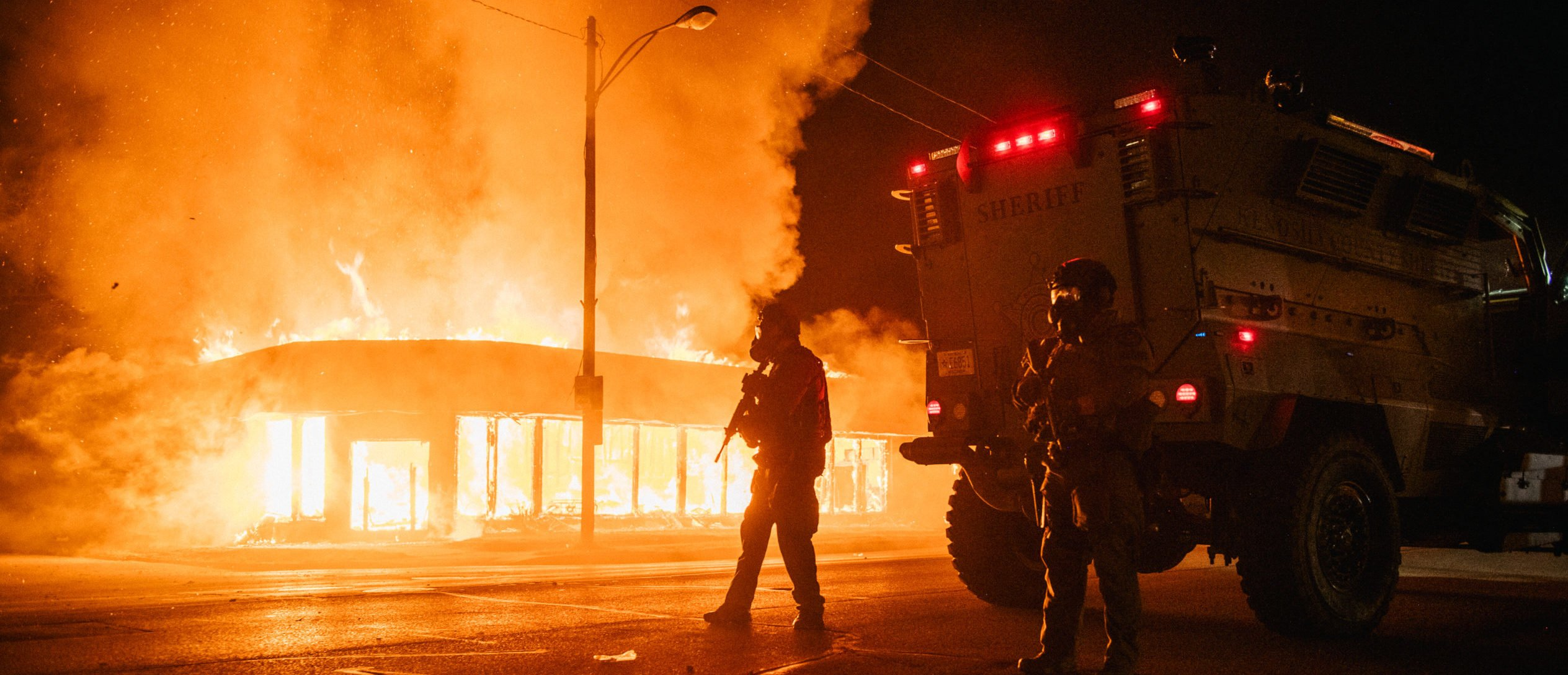 A police armored vehicle patrols an intersection on August 24, 2020 in Kenosha, Wisconsin. This is the second night of rioting after the shooting of Jacob Blake, 29, on August 23. (Brandon Bell/Getty Images)