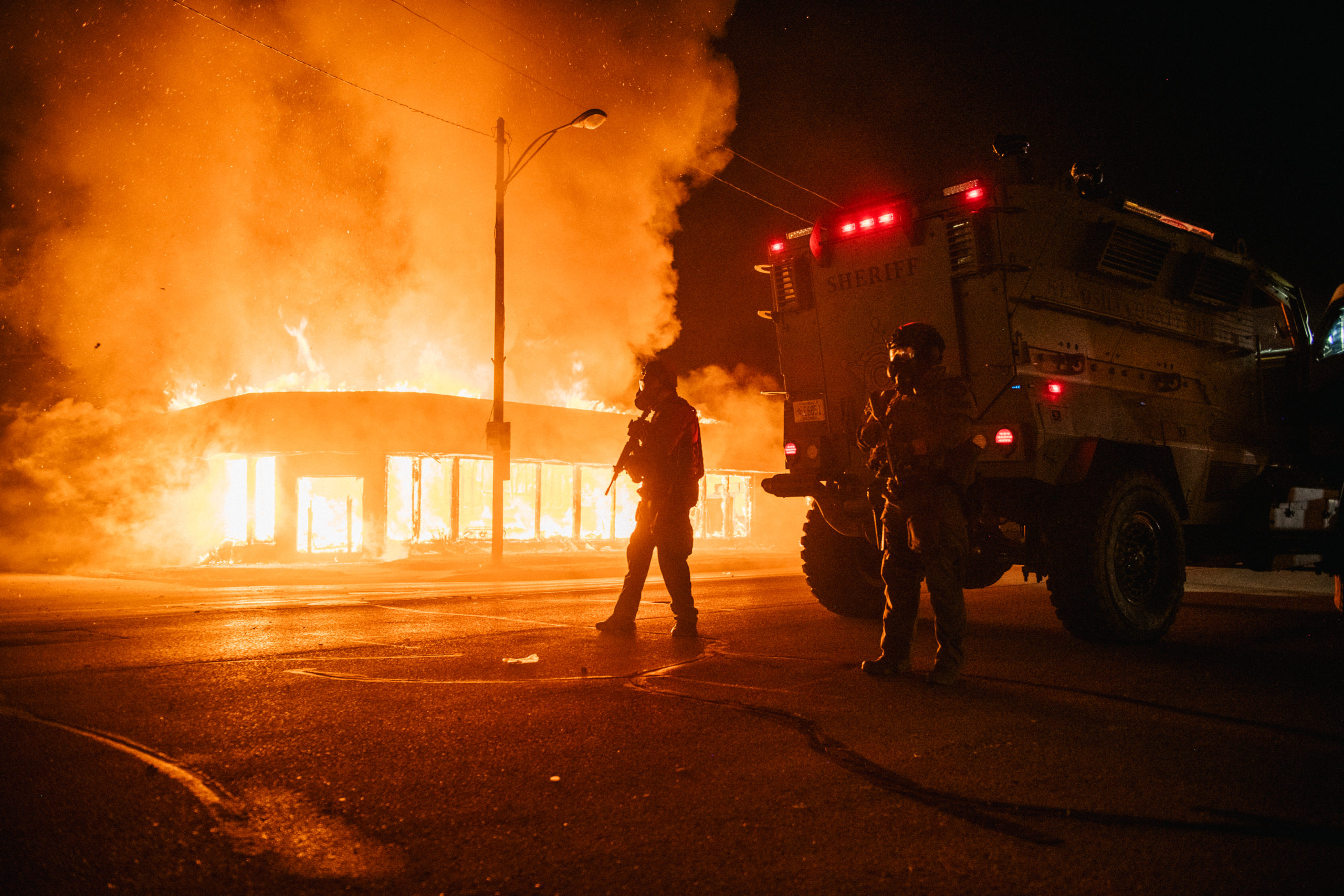 KENOSHA, WI - AUGUST 24: A police armored vehicle patrols an intersection on August 24, 2020 in Kenosha, Wisconsin. This is the second night of rioting after the shooting of Jacob Blake, 29, on August 23. Blake was shot multiple times in the back by Wisconsin police officers after attempting to enter into the drivers side of a vehicle. (Brandon Bell/Getty Images)