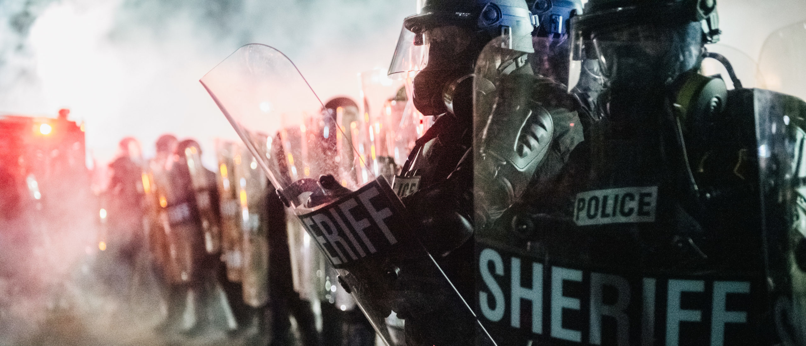 KENOSHA, WI - AUGUST 25: Law enforcement hold a line on August 25, 2020 in Kenosha, Wisconsin. As the city declared a state of emergency curfew, a third night of civil unrest occurred after the shooting of Jacob Blake, 29, on August 23. (Photo by Brandon Bell/Getty Images)