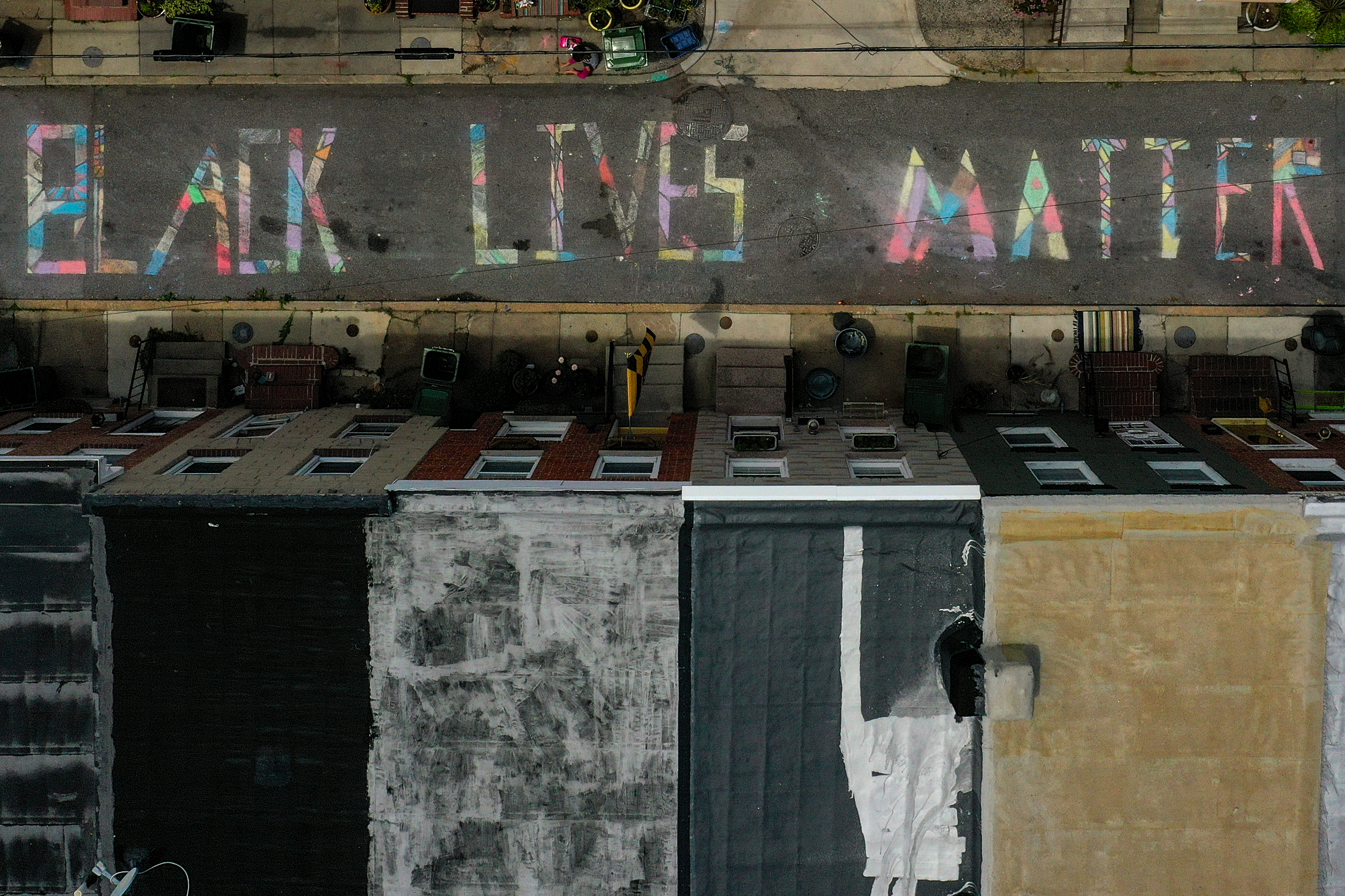 BALTIMORE, MARYLAND - JUNE 16: In an aerial image from a drone, a 'Black Lives Matter' mural chalk painting is seen on the 300 block of South Madeira Street on June 16, 2020 in Baltimore, Maryland. Black Lives Matter has become both a vocal and visual theme as protests have continued worldwide following the police killings of George Floyd in Minneapolis. (Photo by Patrick Smith/Getty Images)