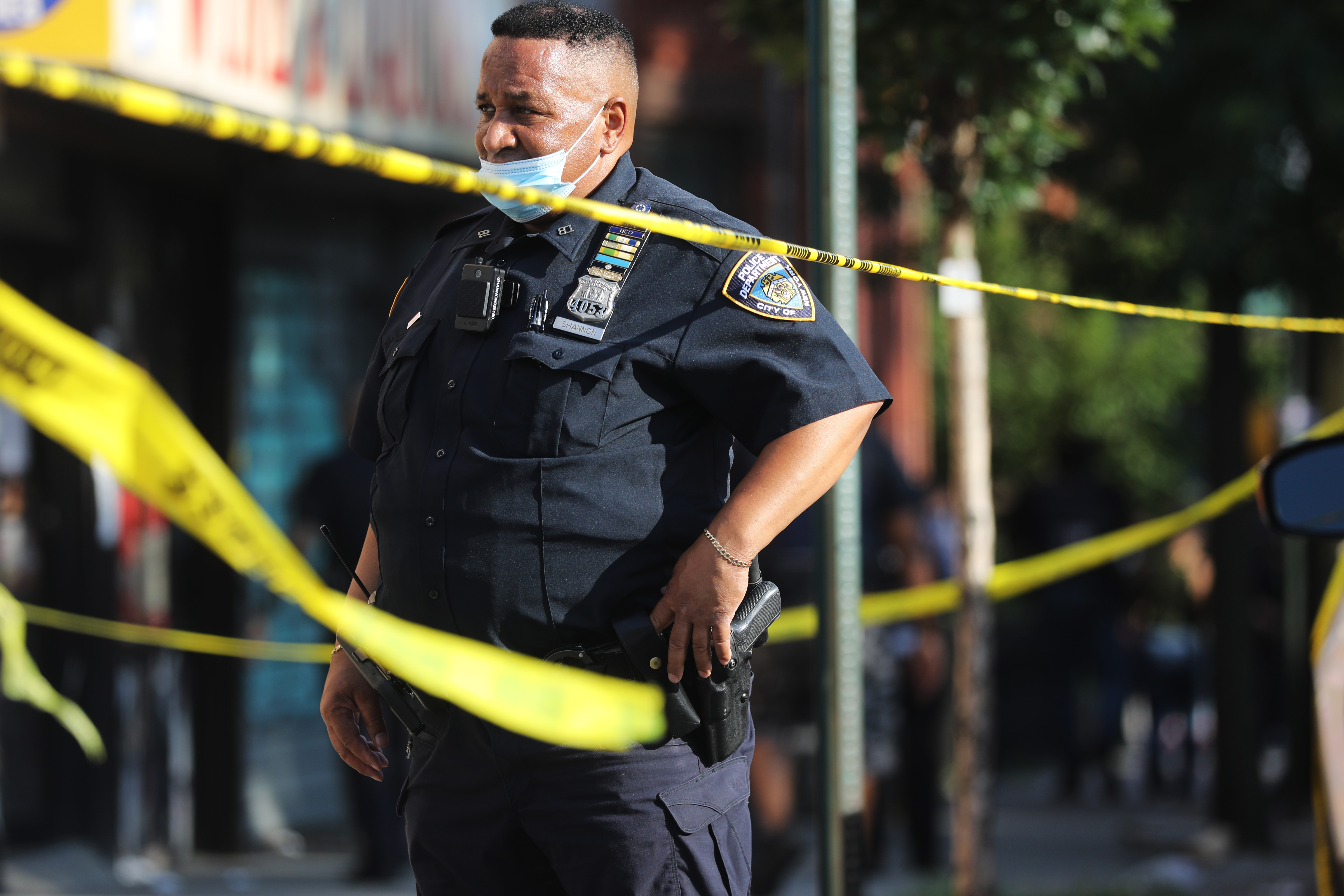 Police stand at the scene of a shooting which happened as Save Our Streets (S.O.S.) was holding a peace march in response to a surge in shootings in the Bedford Stuyvesant neighborhood in Brooklyn on July 16, 2020 in New York City. The march and shooting was held near the scene in Brooklyn where a one-year-old child, Davell Gardner Jr., was recently shot and killed. Davell was shot near a playground during a Sunday picnic when gunfire erupted. Two other adults were wounded in the evening shooting. New York City has witnessed a surge in gun violence over the past month with 9 people killed, including children, and 41 others wounded on the Fourth of July weekend alone. The gun violence is occurring against the backdrop of a nationwide movement to consider defunding police departments. (Photo by Spencer Platt/Getty Images)