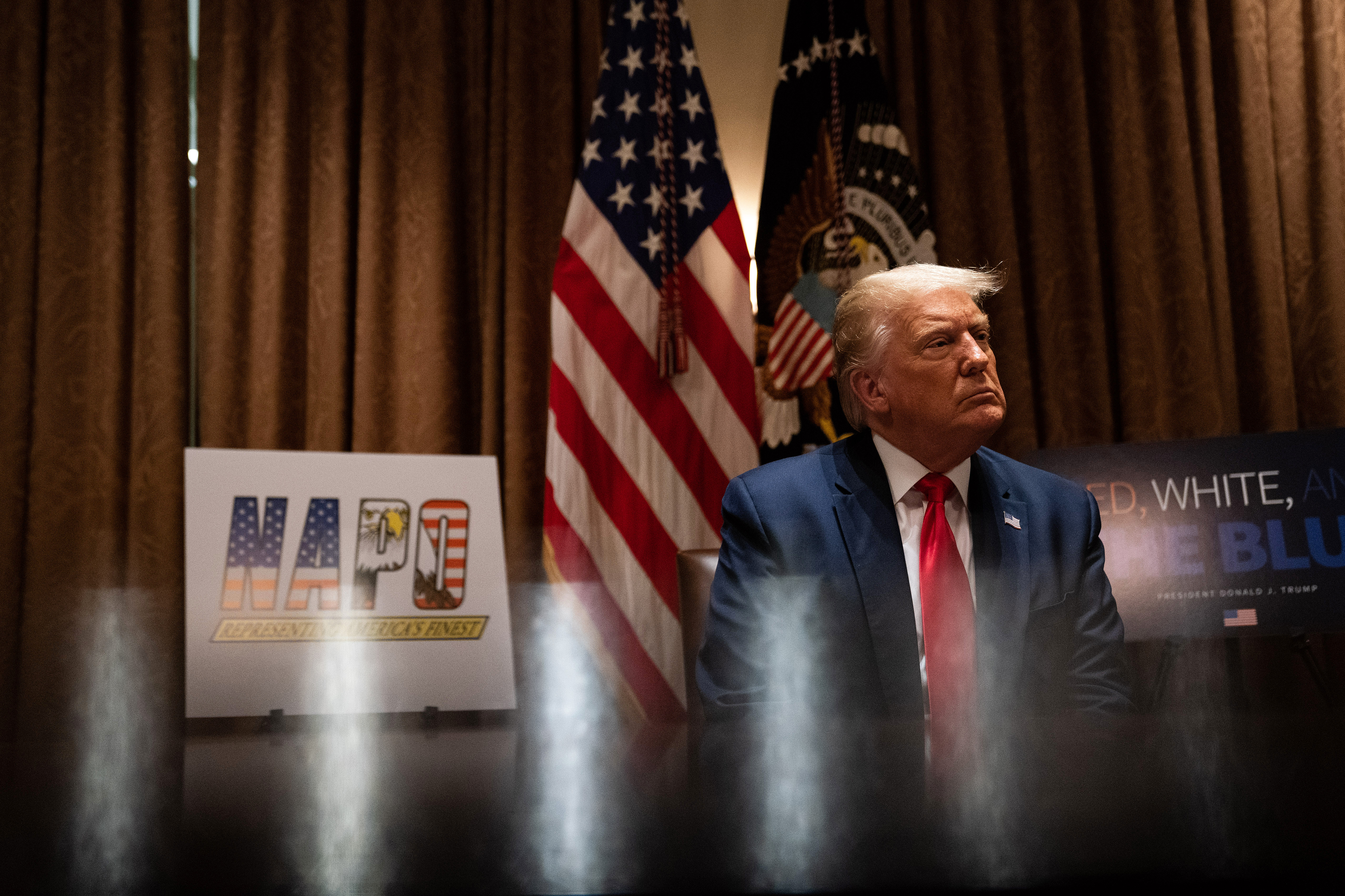 WASHINGTON, DC - JULY 31: U.S. President Donald Trump listens during a meeting with members of the National Association of Police Organizations Leadership in the Cabinet Room of the White House July 31, 2020 in Washington, DC. (Photo by Anna Moneymaker-Pool/Getty Images)