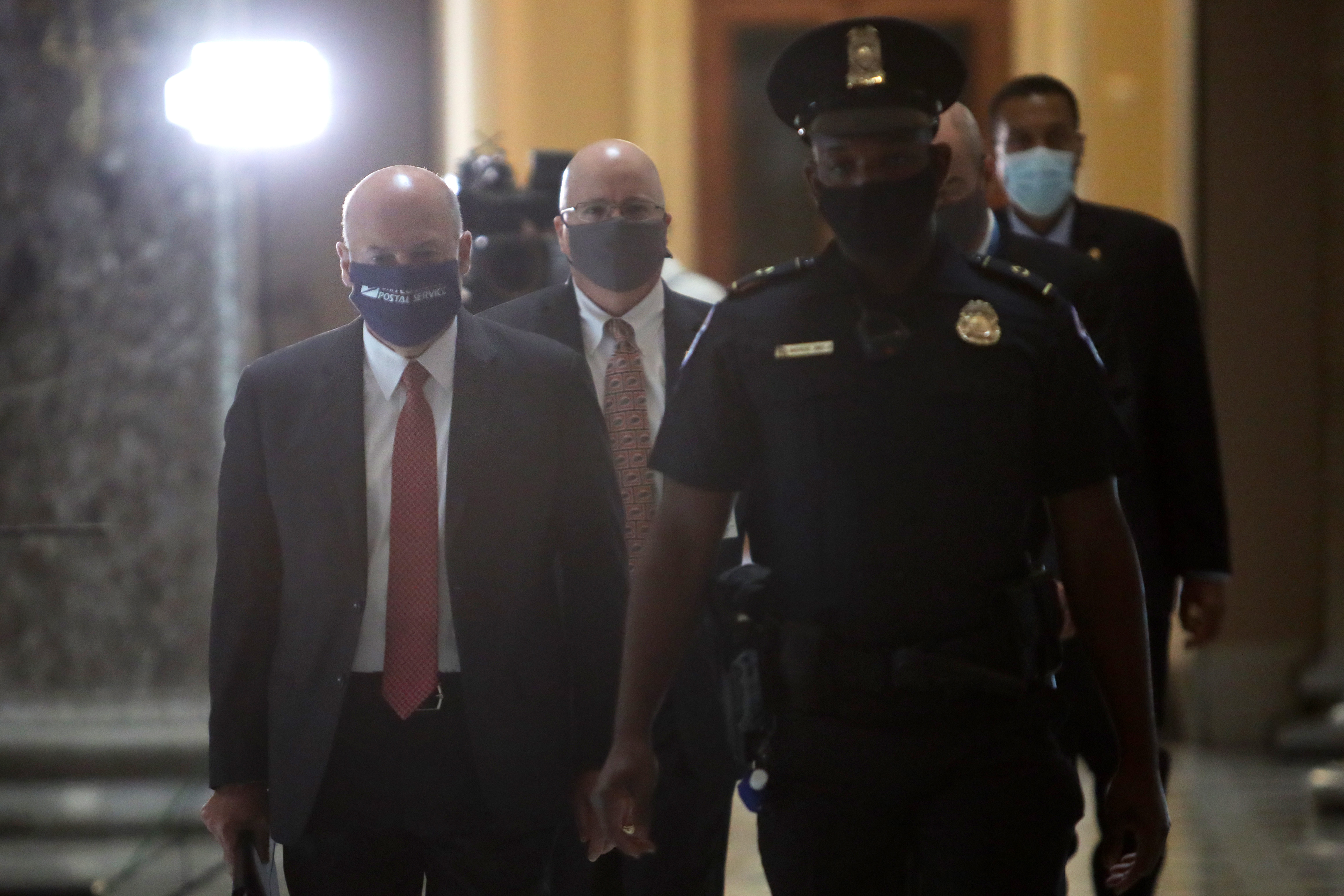 WASHINGTON, DC - AUGUST 05: U.S. Postmaster General Louis Dejoy (L) arrives at a meeting at the office of Speaker of the House Rep. Nancy Pelosi (D-CA) at the U.S. Capitol August 5, 2020 in Washington, DC. Negotiations between Treasury Secretary Steven Mnuchin, Speaker of the House Rep. Nancy Pelosi, Senate Minority Leader Sen. Chuck Schumer and White House Chief of Staff Mark Meadows for an agreement on how to move forward on a new relief package to help people and businesses weather the COVID-19 pandemic continue today at the U.S. Capitol. (Photo by Alex Wong/Getty Images)