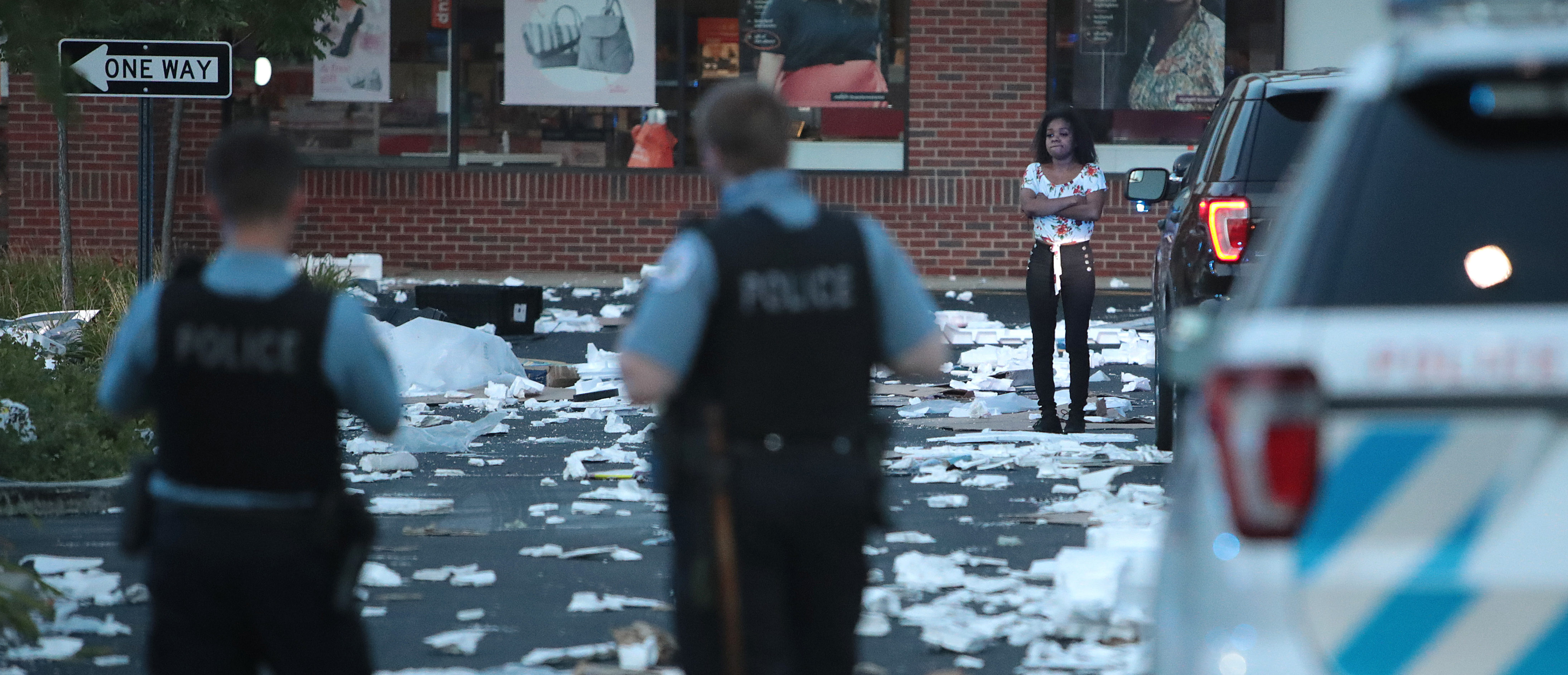 A person stands near a looted store after parts of the city had widespread looting and vandalism, on August 10, 2020 in Chicago, Illinois. (Scott Olson/Getty Images)