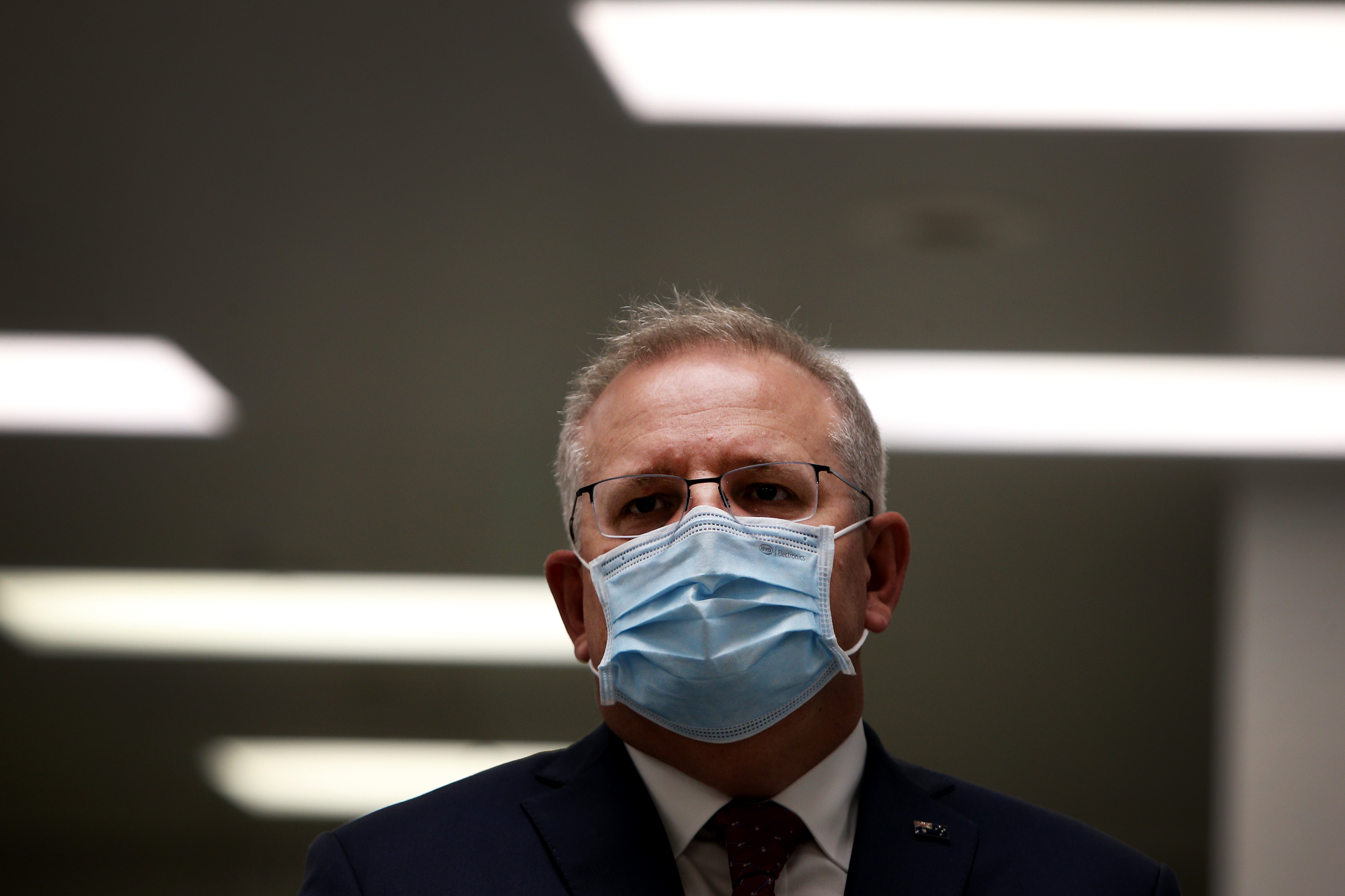 SYDNEY, AUSTRALIA - AUGUST 19: Prime Minister Scott Morrison is seen wearing a face mask during a press conference at AstraZeneca on August 19, 2020 in Sydney, Australia. The Australian government has announced an agreement with the British pharmaceutical giant AstraZeneca to secure at least 25 million doses of a COVID-19 vaccine if it passes clinical trials. The University of Oxford COVID-19 vaccine is currently in phase-three testing. If the vaccine proves to be successful, Australia will manufacture and supply vaccines and will be made available for free. The project could deliver the first vaccines by the end of this year or by early 2021. (Photo by Lisa Maree Williams/Getty Images)