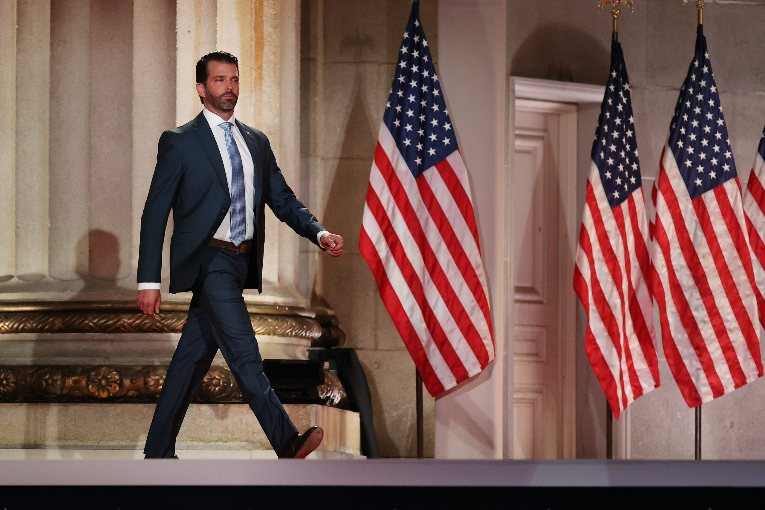 WASHINGTON, DC - AUGUST 24: Donald Trump Jr. steps out on stage before pre-recording his address to the Republican National Convention at the Mellon Auditorium on August 24, 2020 in Washington, DC. The novel coronavirus pandemic has forced the Republican Party to move away from an in-person convention to a televised format, similar to the Democratic Party's convention a week earlier. (Photo by Chip Somodevilla/Getty Images)