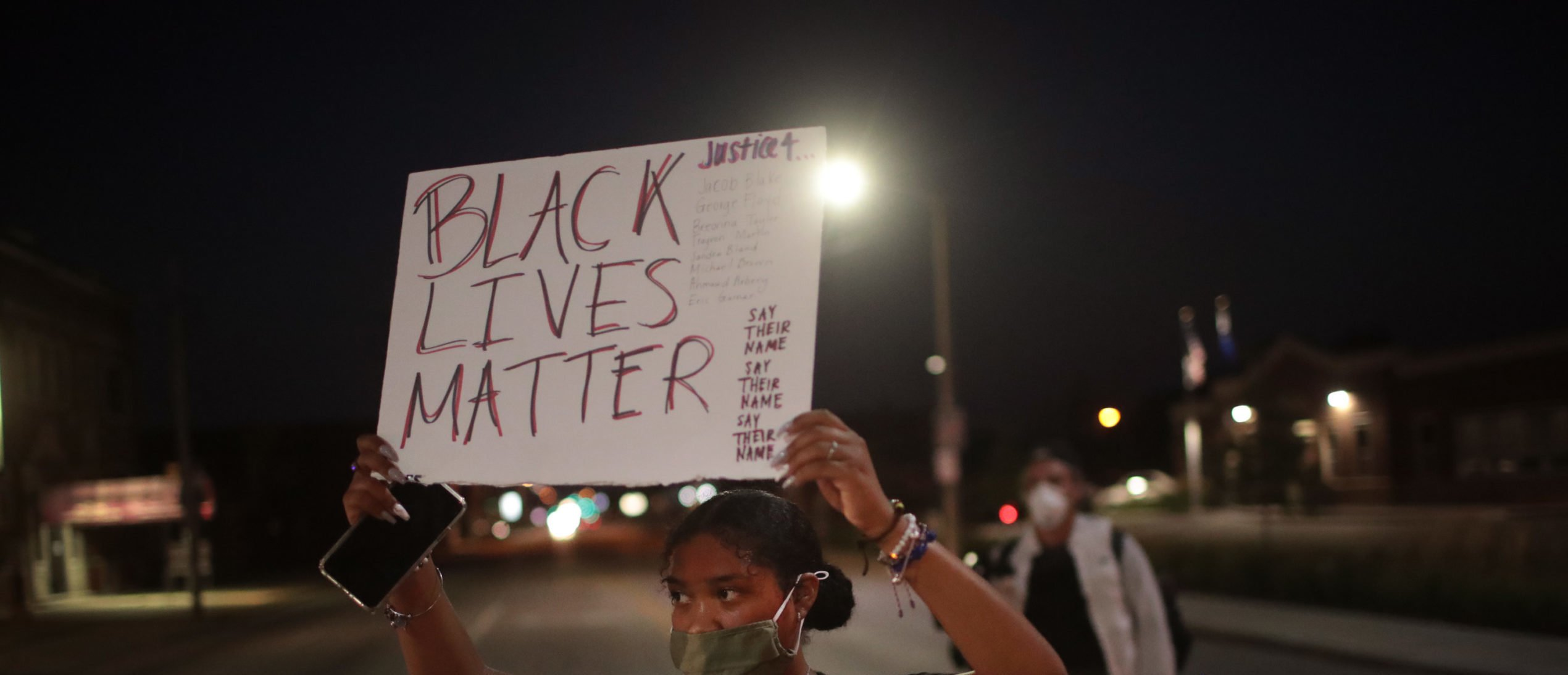 KENOSHA, WISCONSIN - AUGUST 26: Demonstrators protest the shooting of Jacob Blake on August 26, 2020 in Kenosha, Wisconsin. A police officer shot Blake seven times in the back in front of his three children. The shooting sparked three consecutive days of rioting in the city. (Photo by Scott Olson/Getty Images)
