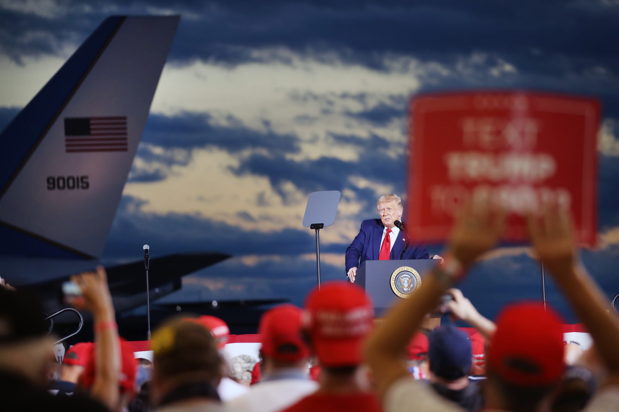 LONDONDERRY, NEW HAMPSHIRE - AUGUST 28: President Donald Trump speaks at an airport hanger at a rally a day after he formally accepted his party's nomination at the Republican National Convention on August 28, 2020 in Londonderry, New Hampshire. Addressing hundreds of supporters, many wearing face masks, Trump made his case for his re-election against his opponent Joe Biden. Trump spoke at at Pro Star Aviation. (Photo by Spencer Platt/Getty Images)
