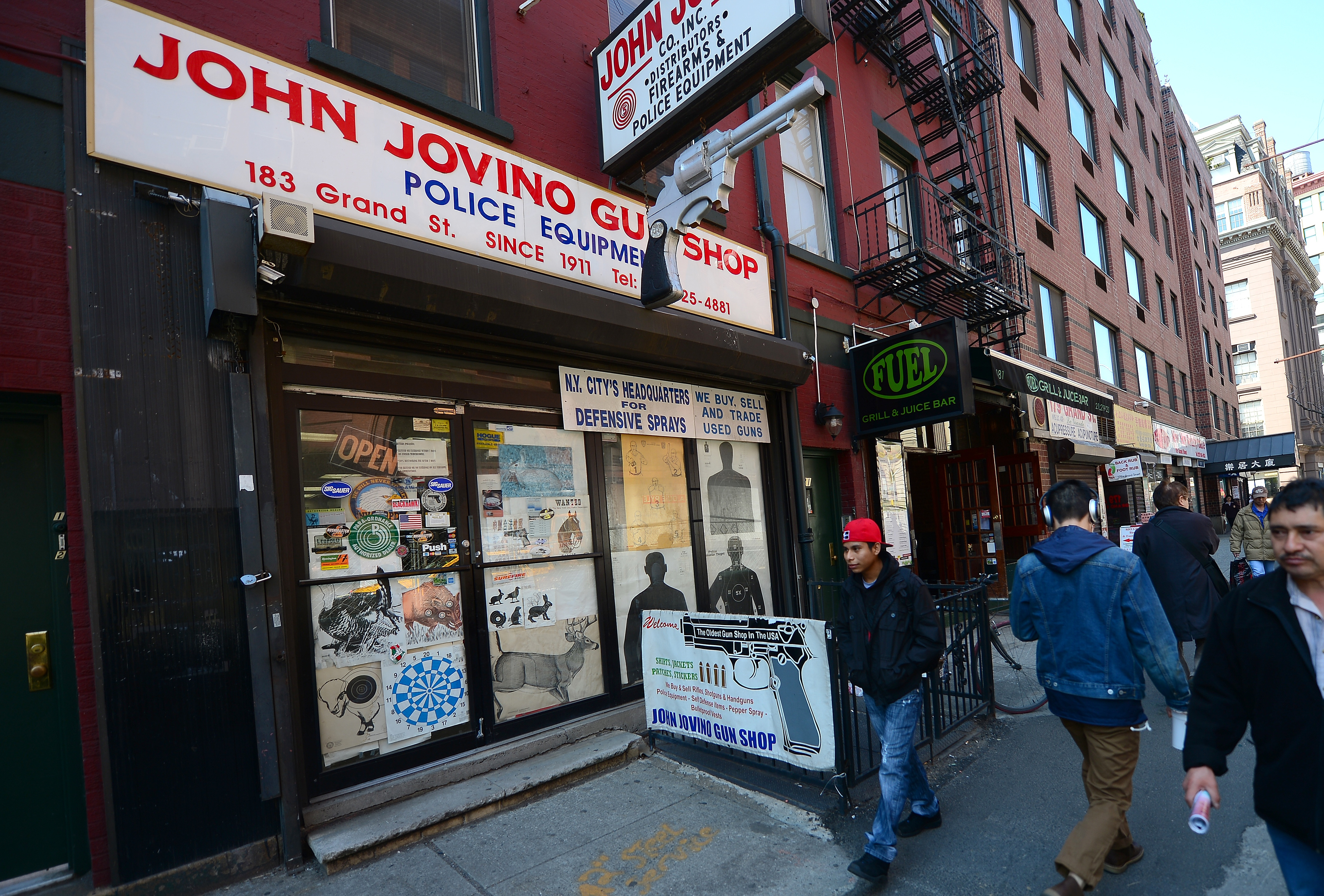 People walk past John Jovino gunshop, the oldest gun retailer in New York City, which claims to be the oldest gun shop in the US, in Manhattan's Little Italy in New York on April 8, 2013. US Congress returns to work on April 8 after a spring-break recess with two issues reaching critical stages, a gun safety legislation in the wake of the Sandy Hook Elementary School shooting and a comprehensive overhaul of the nation's immigration system. (EMMANUEL DUNAND/AFP via Getty Images)