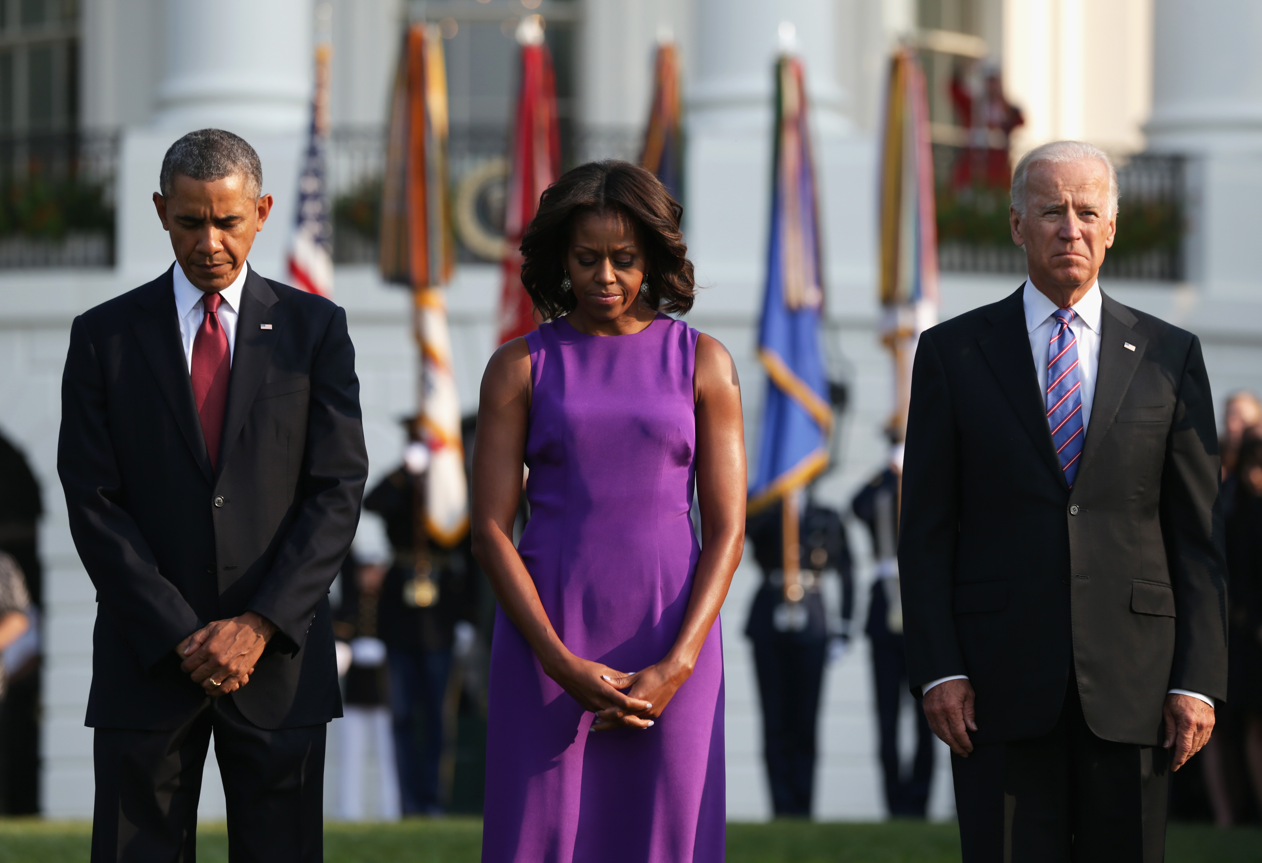 WASHINGTON, DC - SEPTEMBER 11: U.S. President Barack Obama, first lady Michelle Obama and Vice President Joseph Biden observe a moment of silence to mark the 12th anniversary of the 9/11 attacks September 11, 2013 on the South Lawn of the White House in Washington, DC. The nation is commemorating the anniversary of the 2001 attacks which resulted in the deaths of nearly 3,000 people after two hijacked planes crashed into the World Trade Center, one into the Pentagon in Arlington, Virginia and one crash landed in Shanksville, Pennsylvania. (Photo by Alex Wong/Getty Images)
