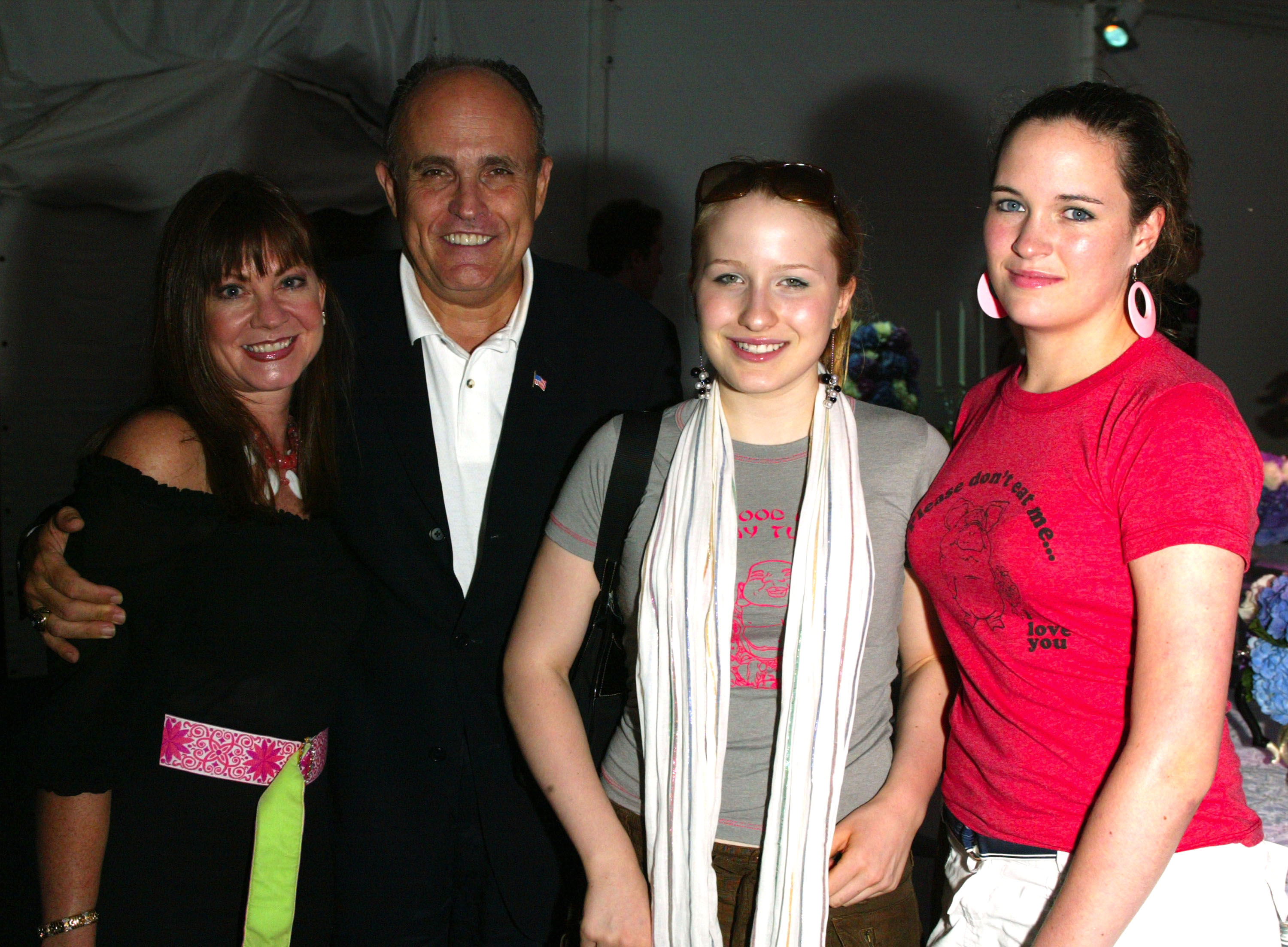 """SOUTHAMPTON, NY - AUGUST 9: (U.S. TABS AND HOLLYWOOD REPORTER OUT) Former New York City Mayor Rudy Giuliani, his wife Judith Nathan, Caroline Nathan and family friend Anne Sullivan attend the afterparty for the Southampton premiere of """"Uptown Girls"""" at the Atlantic Hotel August 9, 2003 in Southampton, New York. (Photo by Matthew Peyton/Getty Images)"""