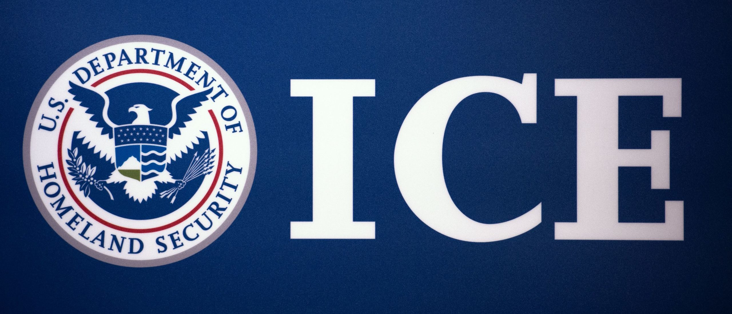 The Immigration and Customs Enforcement (ICE) seal is seen before a press conference discussing ongoing enforcement efforts to combat human smuggling along the Southwest border of the United States, July 22, 2014 at ICE headquarters in Washington, DC. AFP Photo/Paul J. Richards (PAUL J. RICHARDS/AFP via Getty Images)