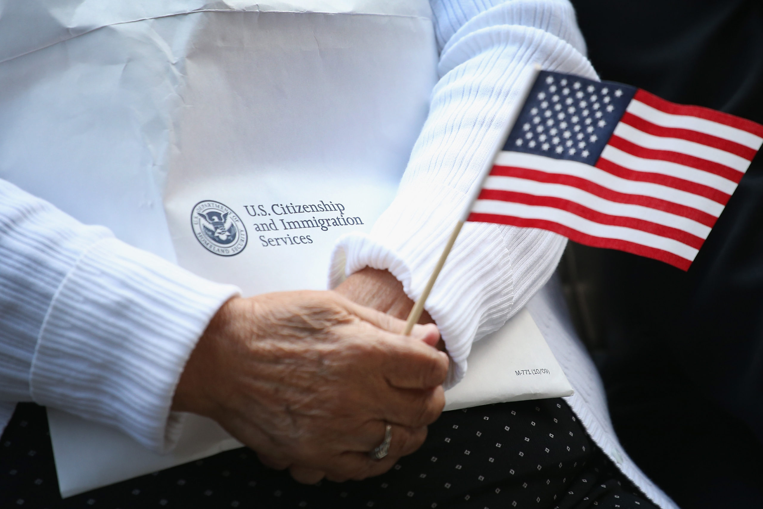 CHICAGO, IL - SEPTEMBER 16: Immigrants from 25 countries participate in a naturalization ceremony in Daley Plaza on September 16, 2014 in Chicago, Illinois. Seventy people were awarded their U.S. citizenship at the Citizenship Day ceremony. (Photo by Scott Olson/Getty Images)
