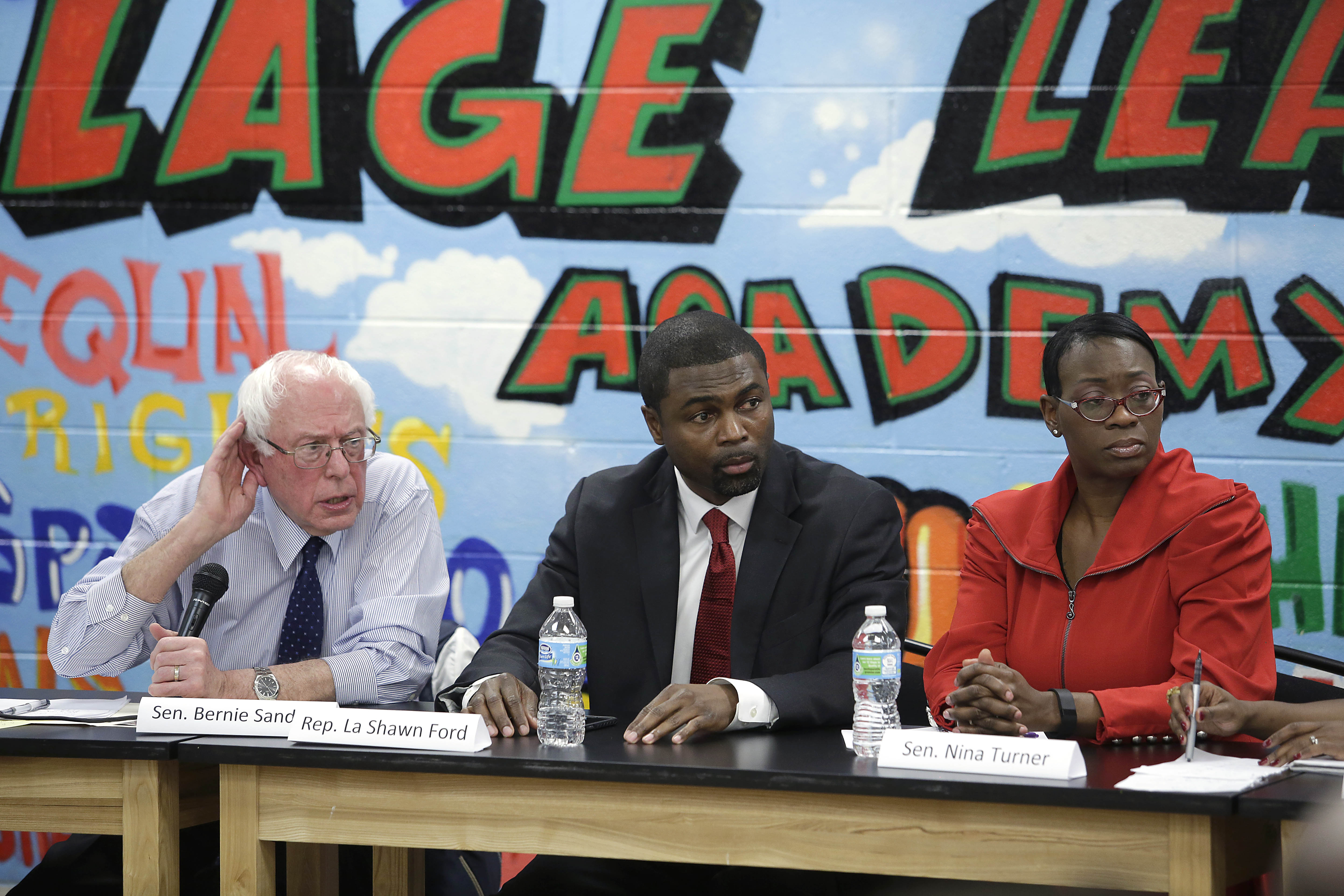 CHICAGO, IL - DECEMBER 23: Democratic presidential candidate U.S. Senator Bernie Sanders (I-VT), left, State Representative La Shawn Ford (D-IL), center, and former Ohio State Senator Nina Turner listen listen to a question for Sanders during a round table meeting with local activist and community members December 23, 2015 in Chicago, Illinois. Sanders, who is seeking the nomination from the Democratic Party talked about police reform and preventing people of color from being victimized by police officers across the country. (Joshua Lott/Getty Images)