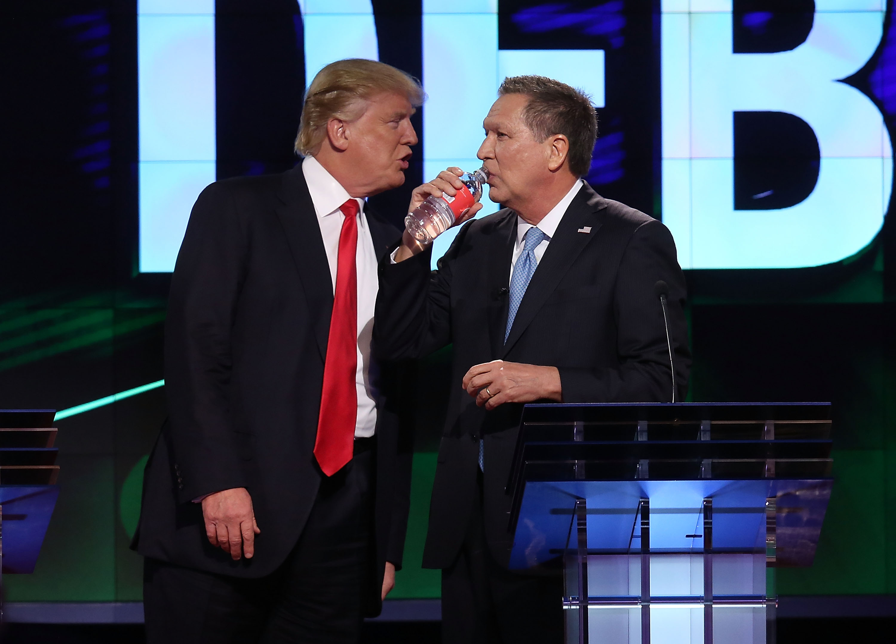 CORAL GABLES, FL - MARCH 10: Republican presidential candidates, Donald Trump and Ohio Gov. John Kasich are seen during a broadcast break of the CNN, Salem Media Group, The Washington Times Republican Presidential Primary Debate on the campus of the University of Miami on March 10, 2016 in Coral Gables, Florida. The candidates continue to campaign before the March 15th Florida primary. (Photo by Joe Raedle/Getty Images)