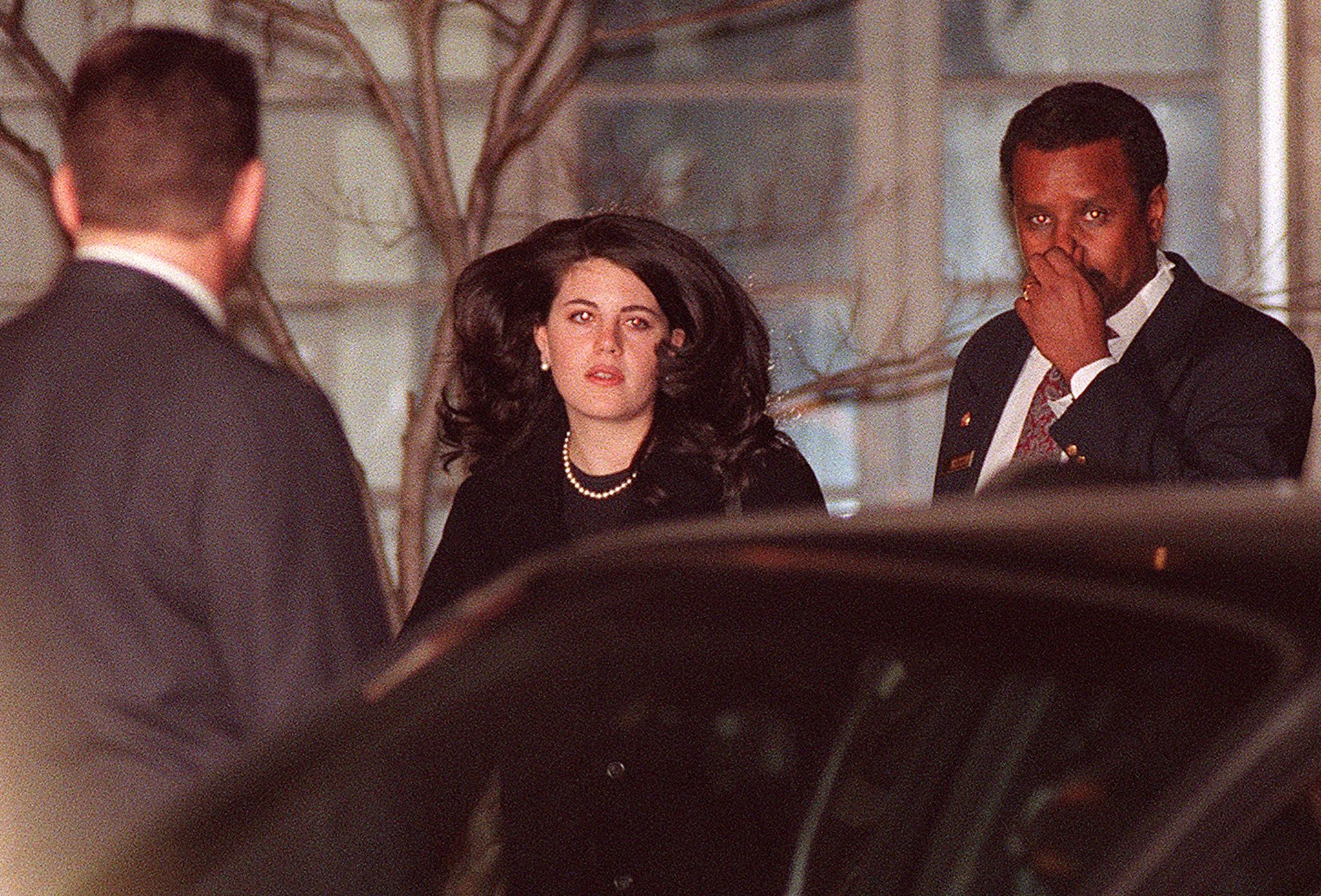 Monica Lewinsky (C), the former White House intern who allegedly had an affair with US President Bill Clinton, walks to a waiting car 29 January at the Cosmos Club in Washington DC. (TIMOTHY CLARY/AFP via Getty Images)