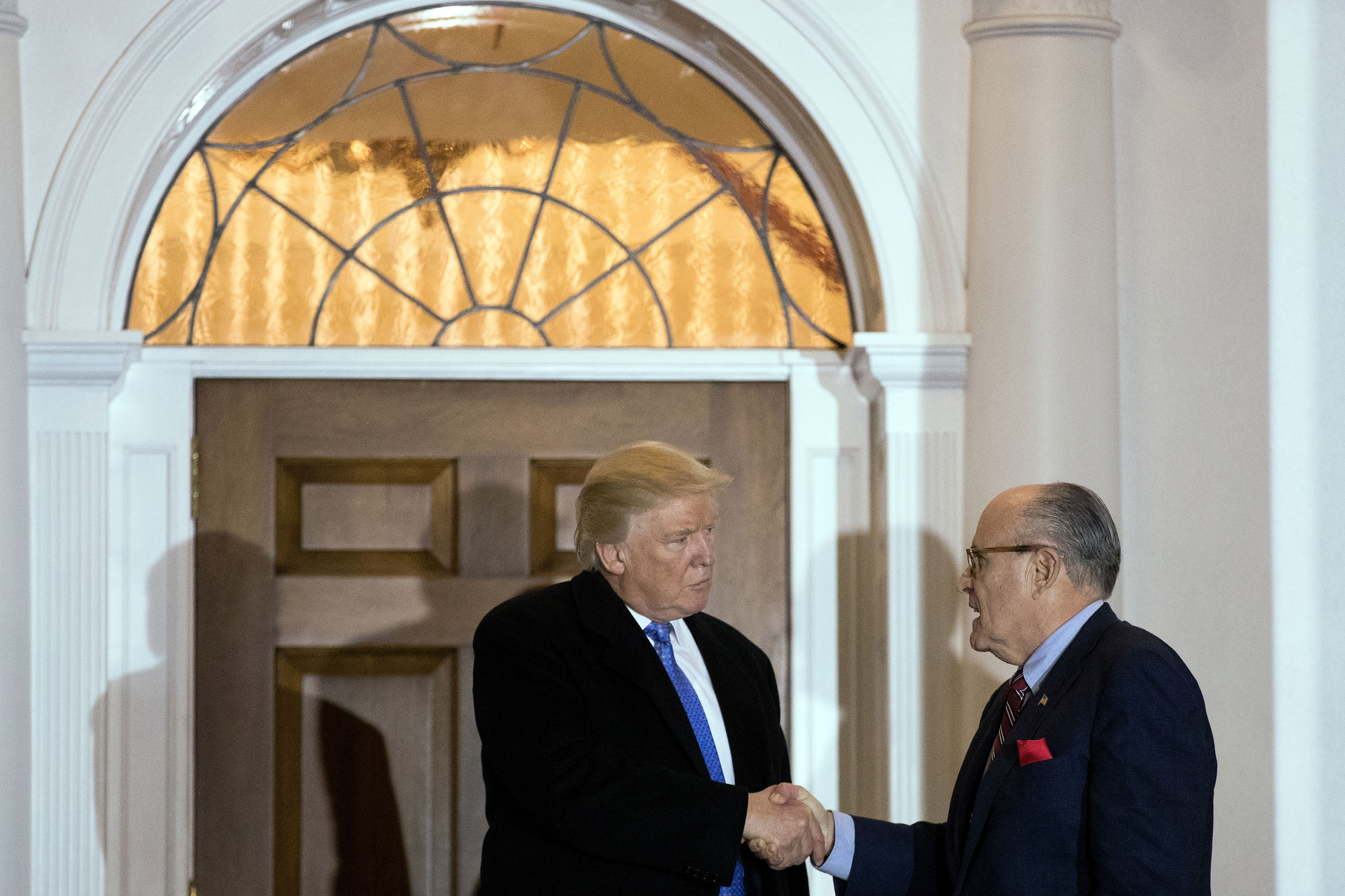 BEDMINSTER TOWNSHIP, NJ - NOVEMBER 20: (L to R) President-elect Donald Trump and former New York City mayor Rudy Giuliani shake hands following their meeting at Trump International Golf Club, November 20, 2016 in Bedminster Township, New Jersey. Trump and his transition team are in the process of filling cabinet and other high level positions for the new administration. (Photo by Drew Angerer/Getty Images)