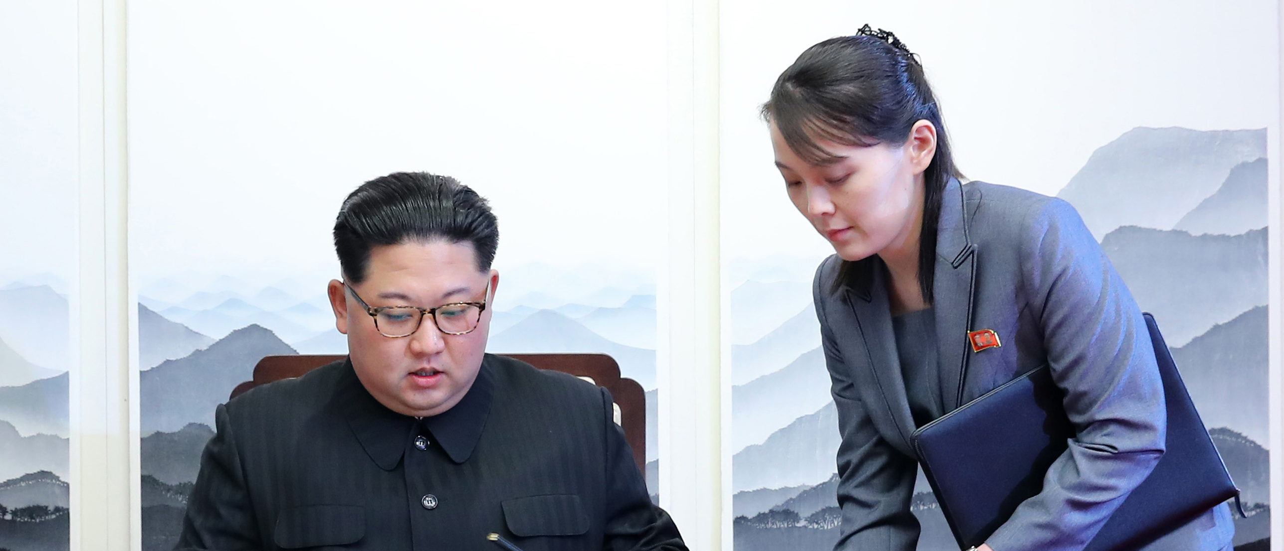 North Korea's leader Kim Jong Un (L) signs the guest book next to his sister Kim Yo Jong (R) during the Inter-Korean summit with South Korea's President Moon Jae-in at the Peace House building on the southern side of the truce village of Panmunjom on April 27, 2018. - North Korean leader Kim Jong Un and the South's President Moon Jae-in sat down to a historic summit on April 27 after shaking hands over the Military Demarcation Line that divides their countries in a gesture laden with symbolism. (Photo by Korea Summit Press Pool / Korea Summit Press Pool / AFP) (Photo credit should read KOREA SUMMIT PRESS POOL/AFP via Getty Images)