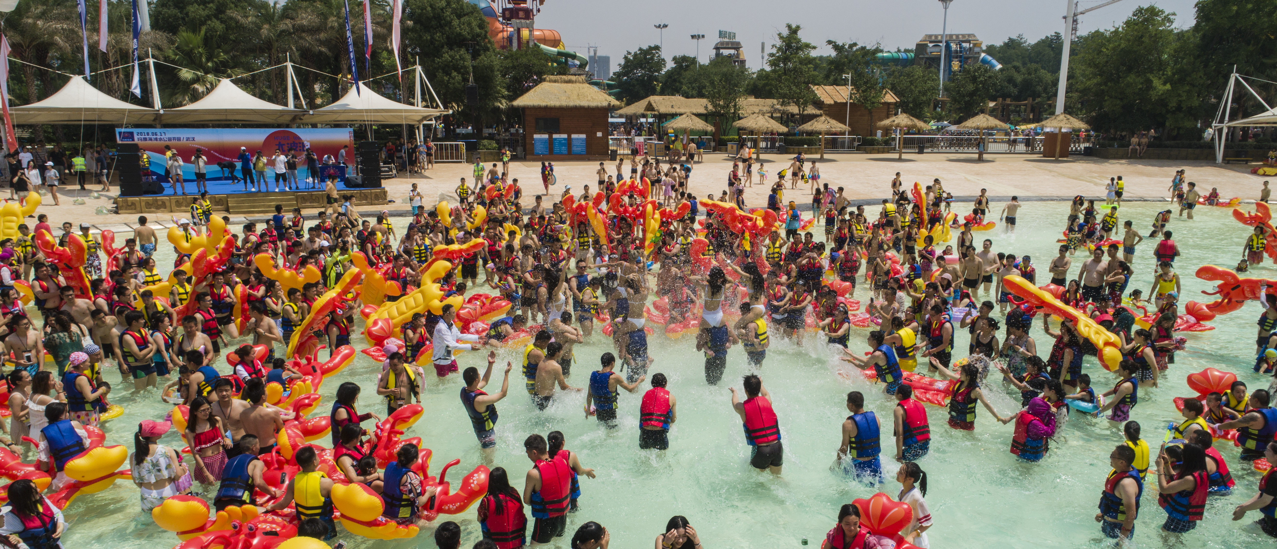 WUHAN, CHINA - JUNE 17: People play with crayfish inflatables at Playa Maya water park on June 17, 2018 in Wuhan, Hubei Province of China. (Photo by VCG/VCG via Getty Images)