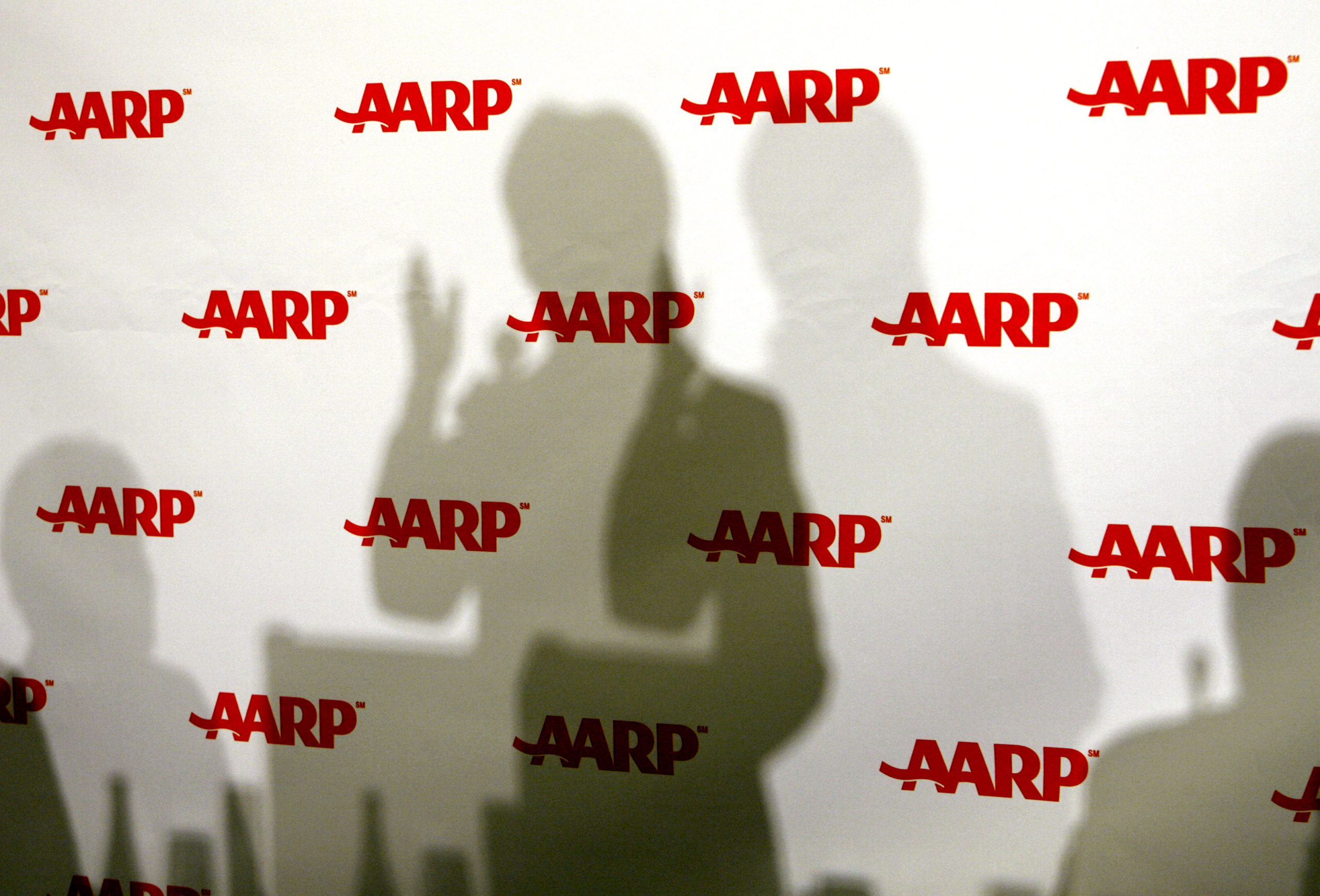 The shadow of U.S. Senator Hillary Clinton is seen as she speaks at the annual public policy meeting of AARP in Washington in 2007. (Kevin Lamarque/Reuters)