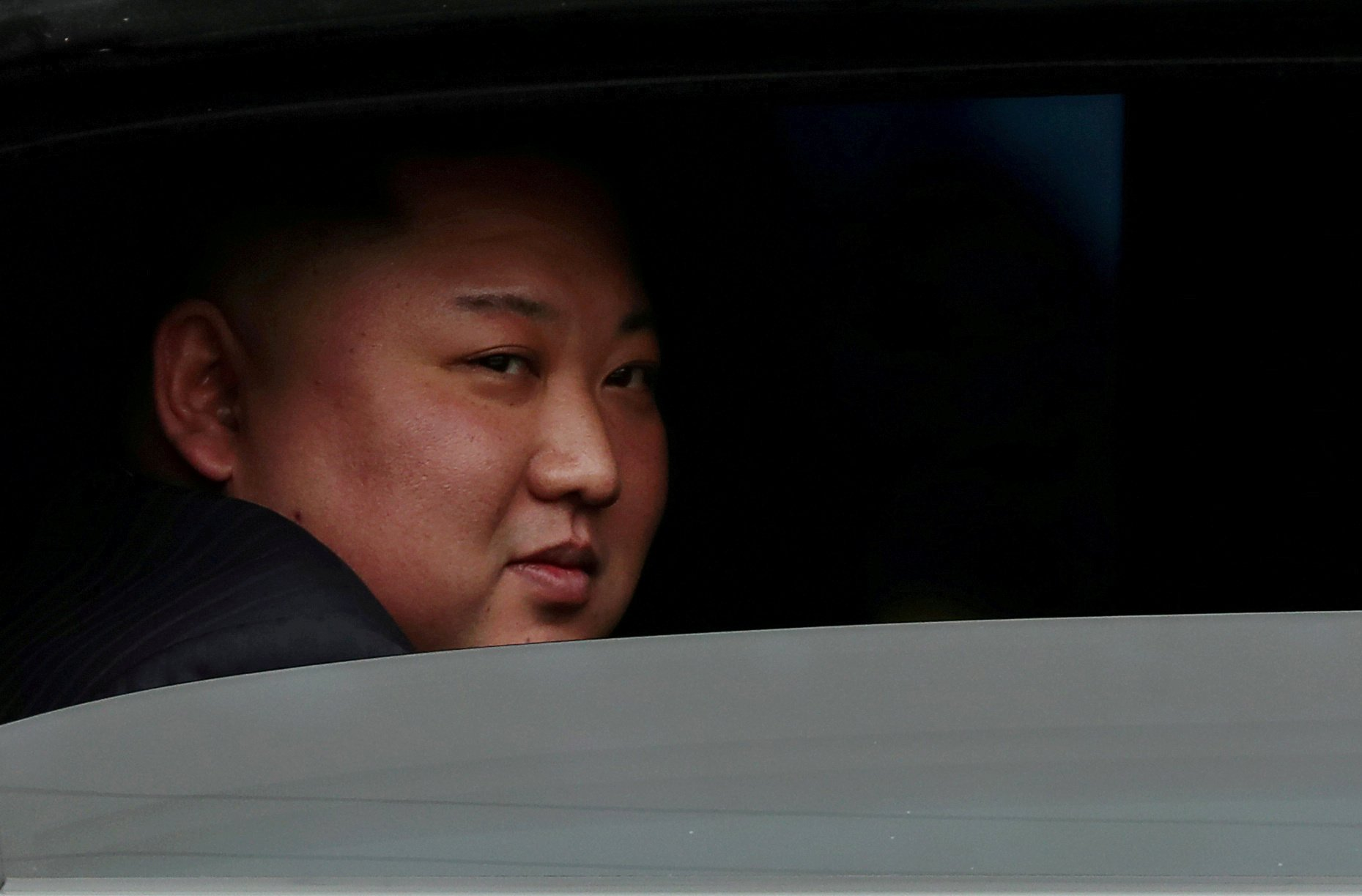 North Korea's leader Kim Jong Un sits in his vehicle after arriving at a railway station in Dong Dang, Vietnam, at the border with China, February 26, 2019. REUTERS/Athit Perawongmetha//File Photo